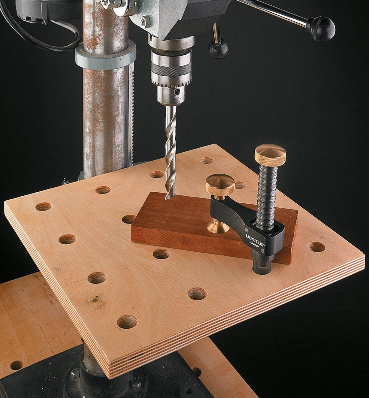 Veritas Surface Clamp holding stock on a drill press table