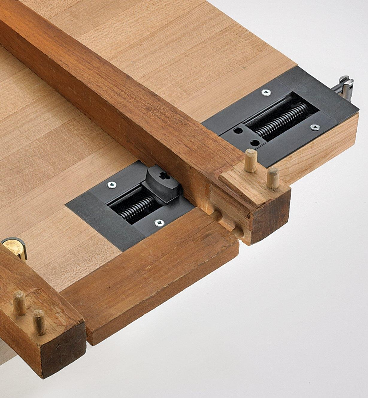 Inset vise being used to disassemble the legs of a small table
