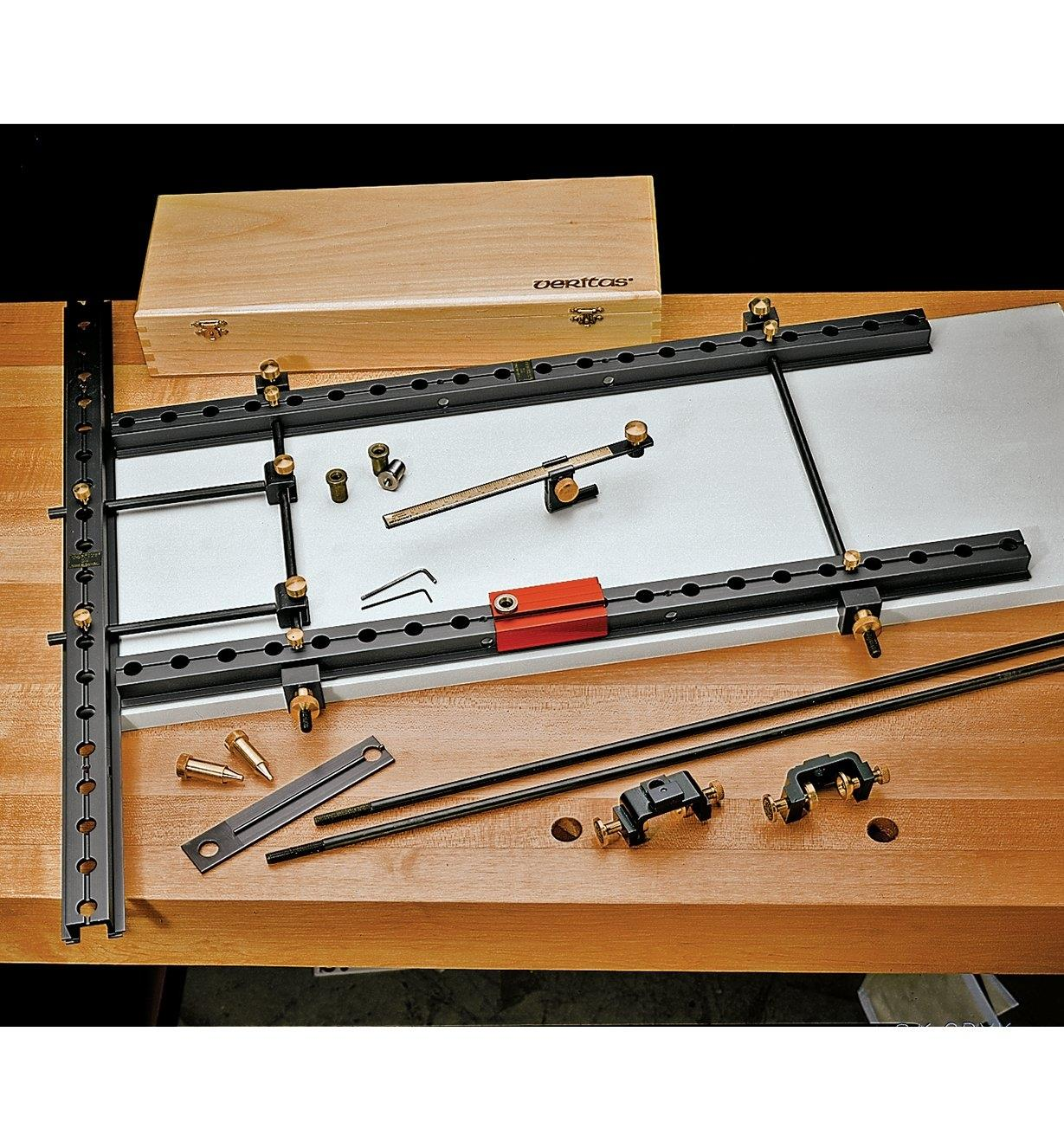 Deluxe System components displayed on a workbench, with rails clamped onto a panel
