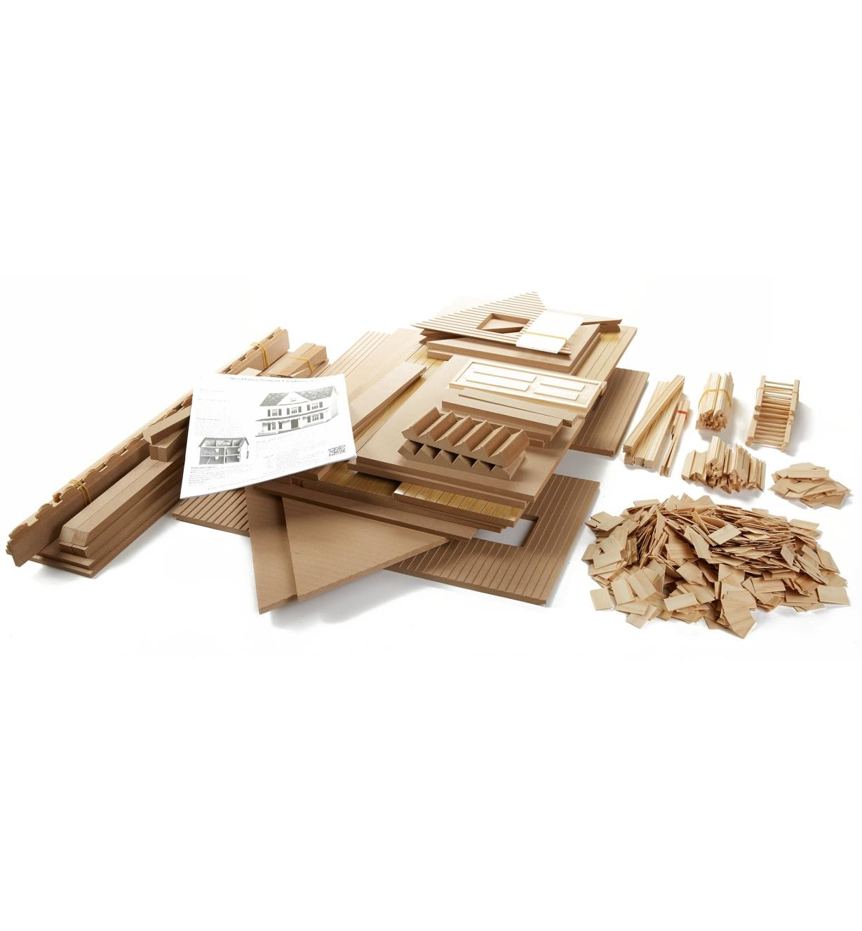 Components of the dollhouse kit before assembly