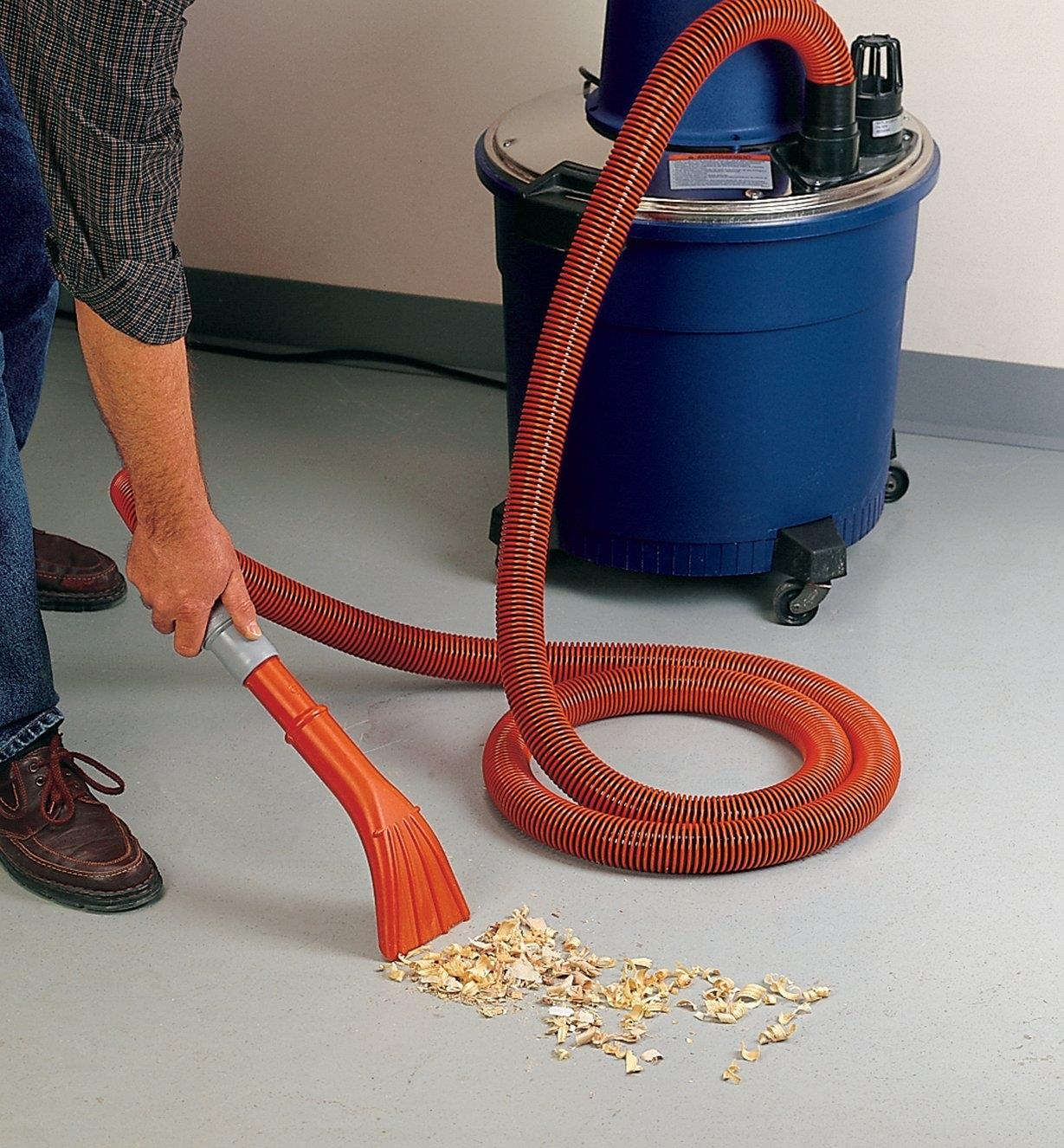 Vacuuming wood chips using the claw tool on the wet/dry vacuum accessory kit