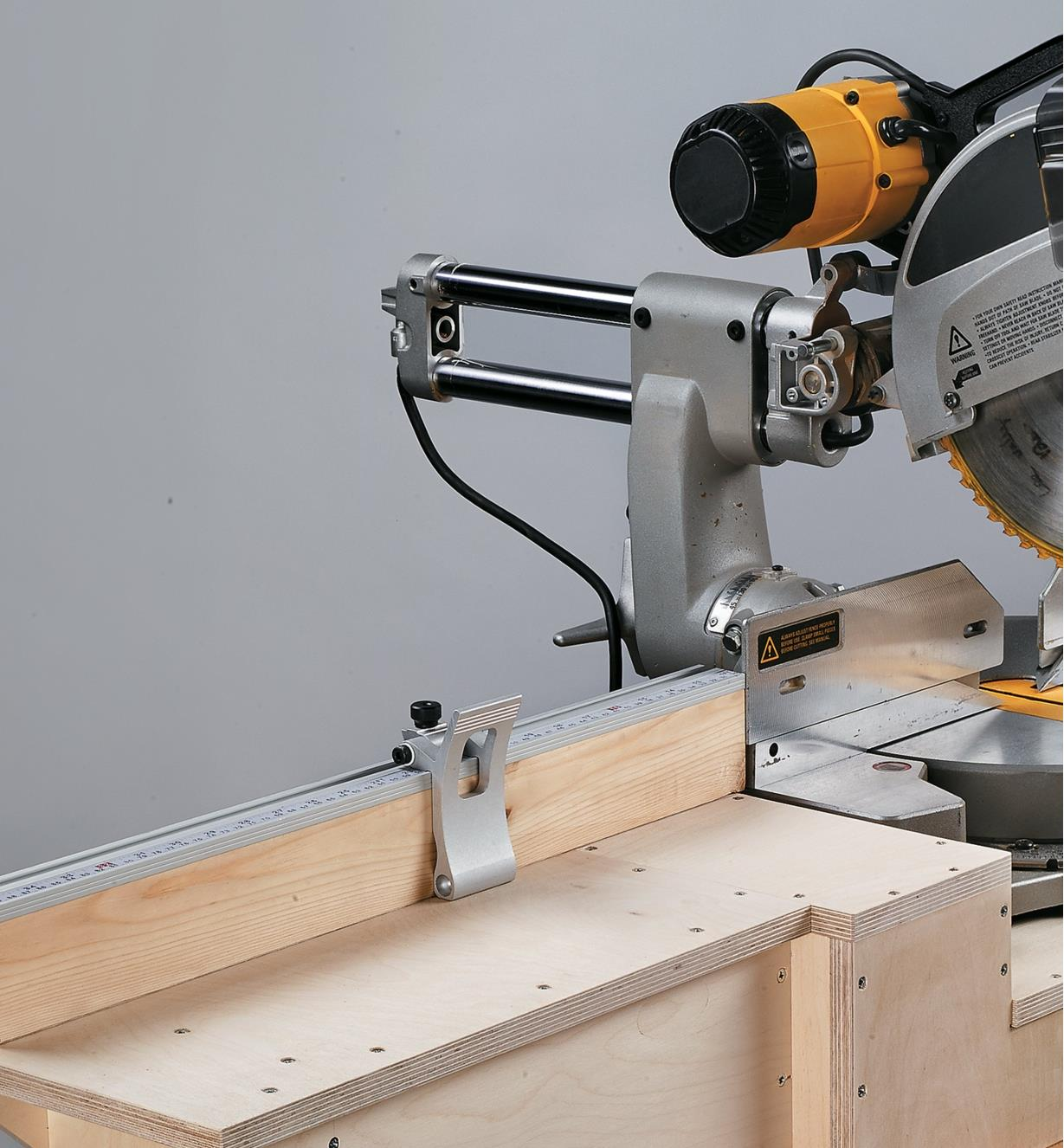 Flip stop in use on a miter saw stand