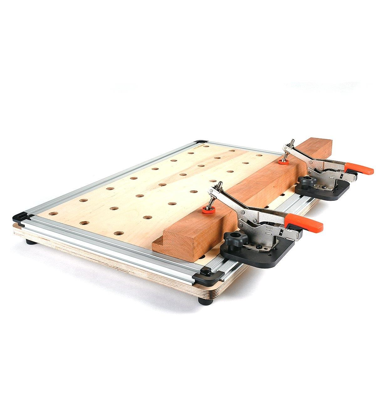 Quad t-slot track mounted to a custom work surface with wood held on the top by two toggle clamps