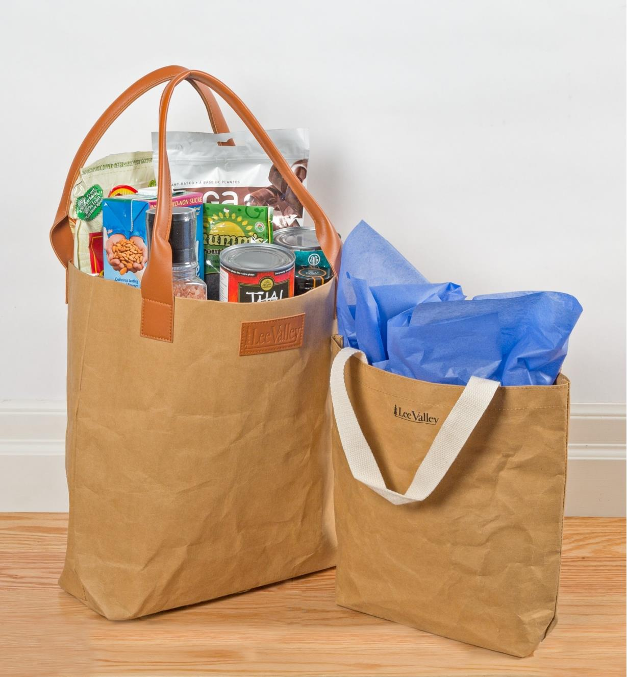 Two Tree Leather Tote Bags, one filled with groceries and the other used as a gift bag