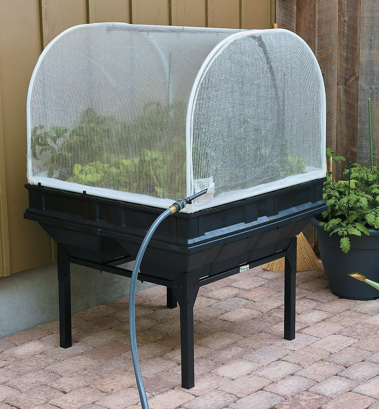 Vegepod Container Garden with a stand growing vegetables on a patio