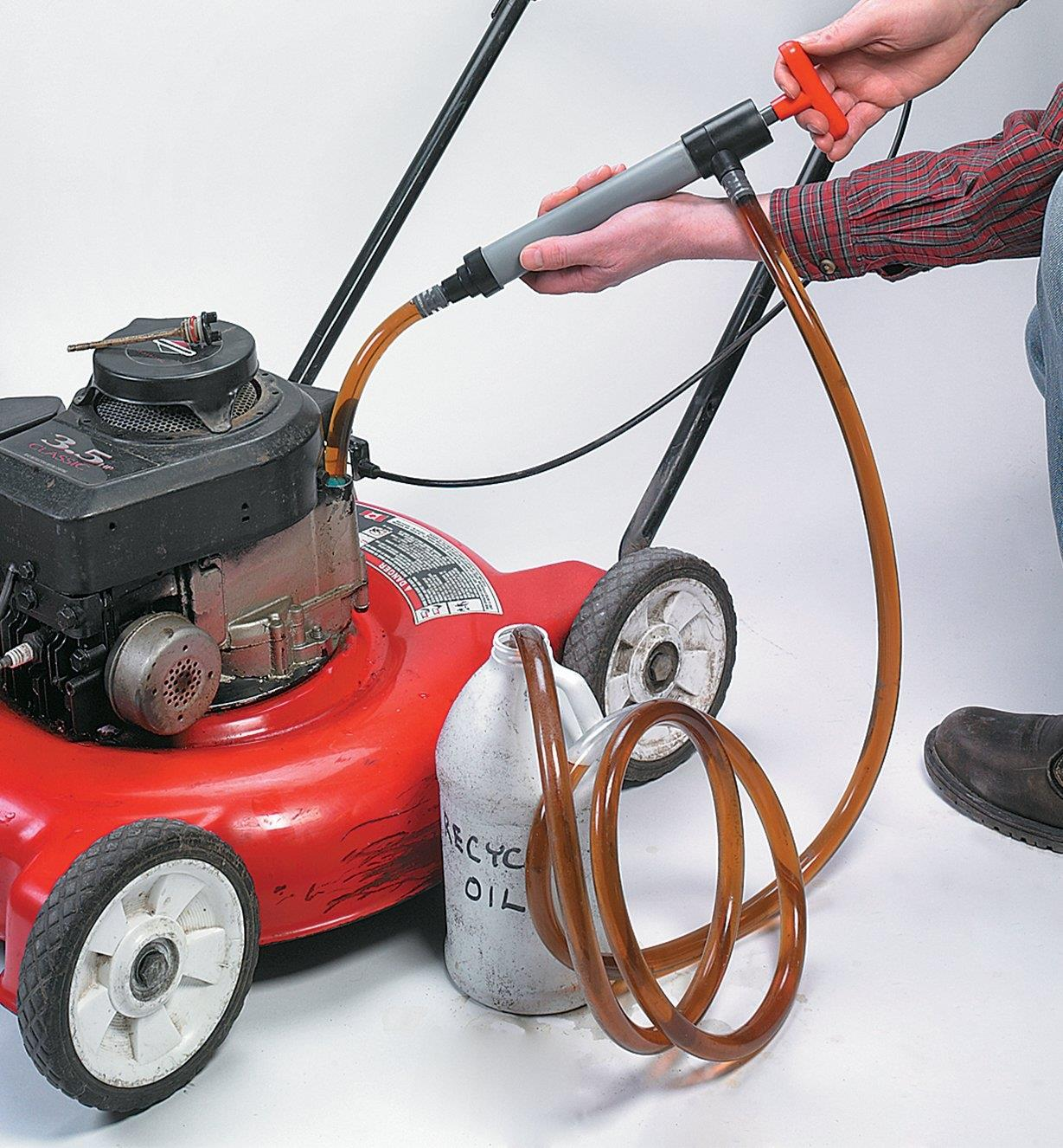 Transfer Siphon Pump removing oil from a lawnmower