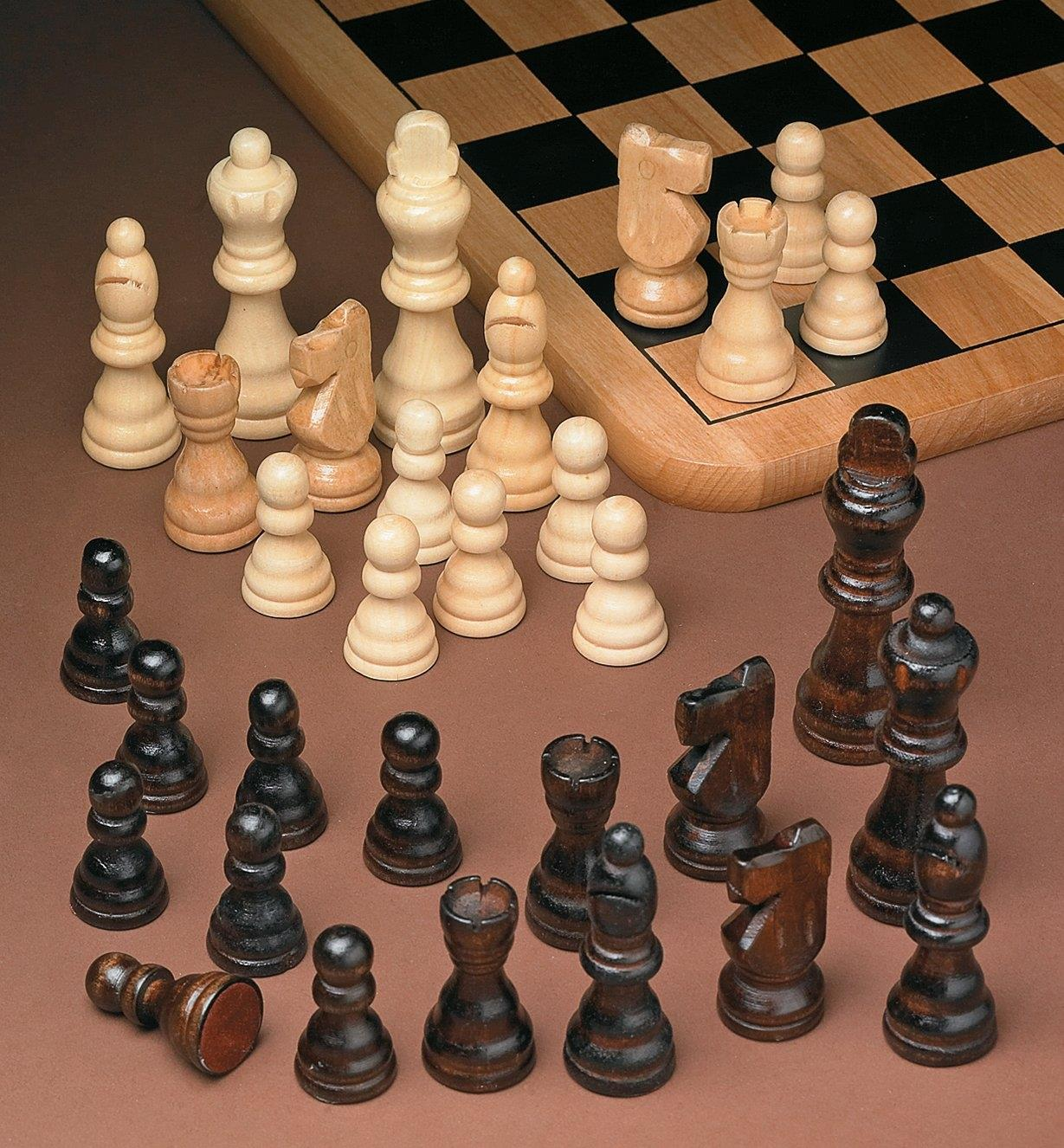 Wooden Chess Pieces arranged next to a chess board