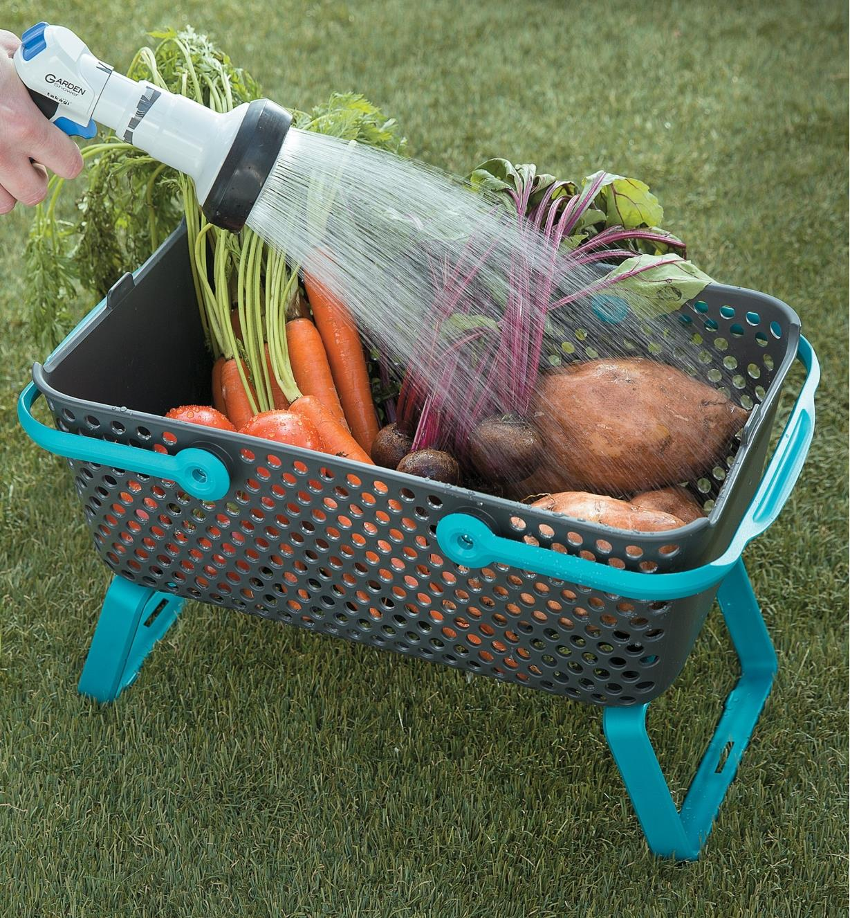 Rinsing garden vegetables in the Medium Stacking Basket