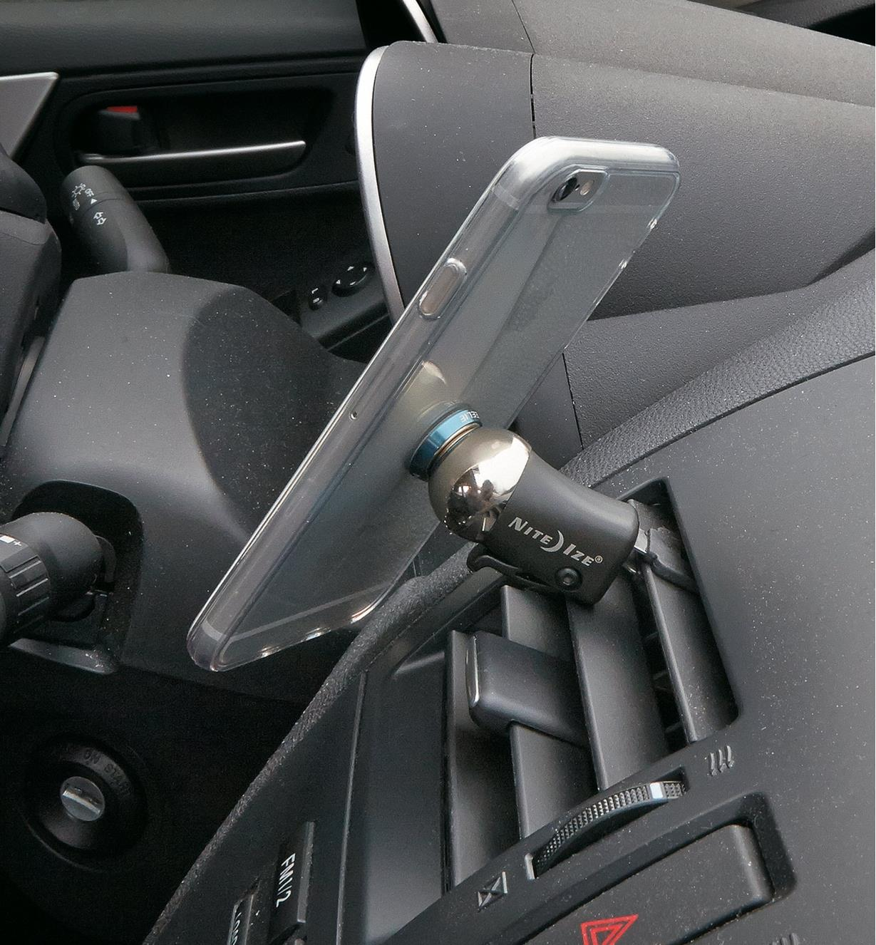 Steelie Mobile Device Vent Mount attached to a car vent, holding a cell phone