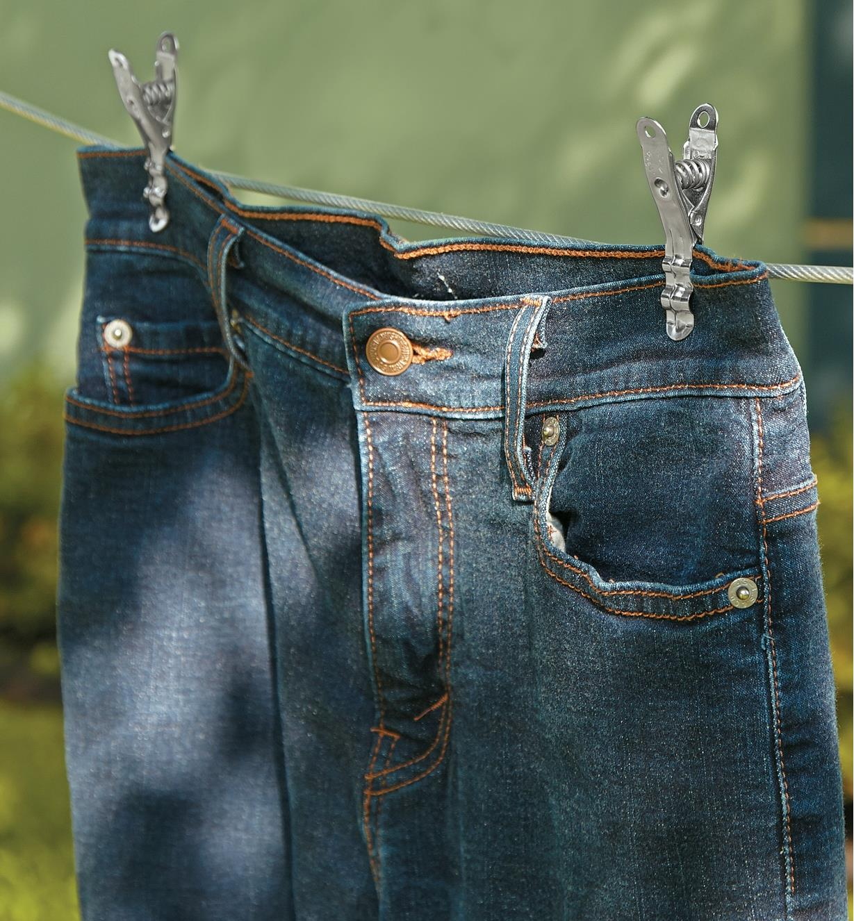 Lifetime Clothespins holding jeans on a clothesline