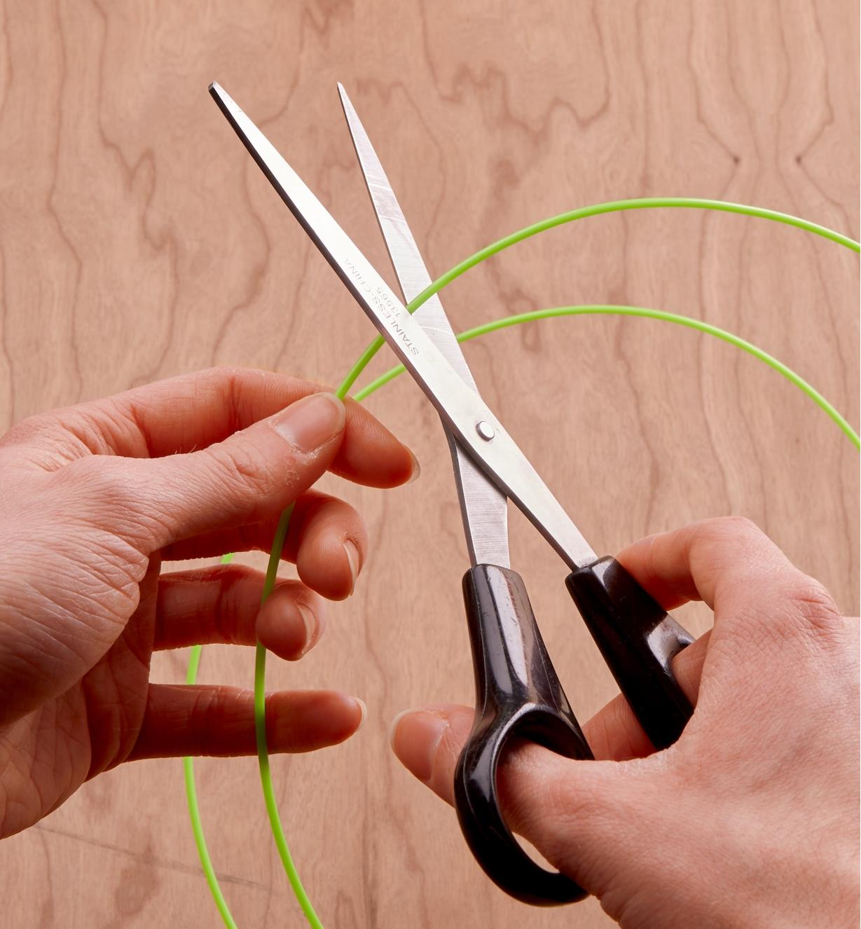 Cutting the FlexStraw with a pair of scissors
