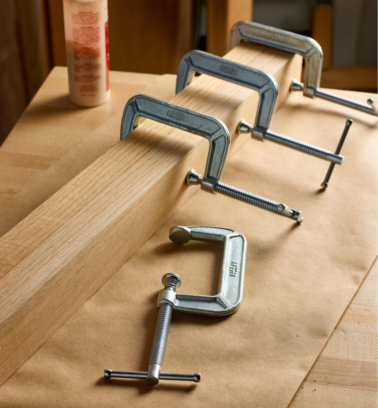 Bessey C-clamps being used to hold a wooden project assembly together during glue-up