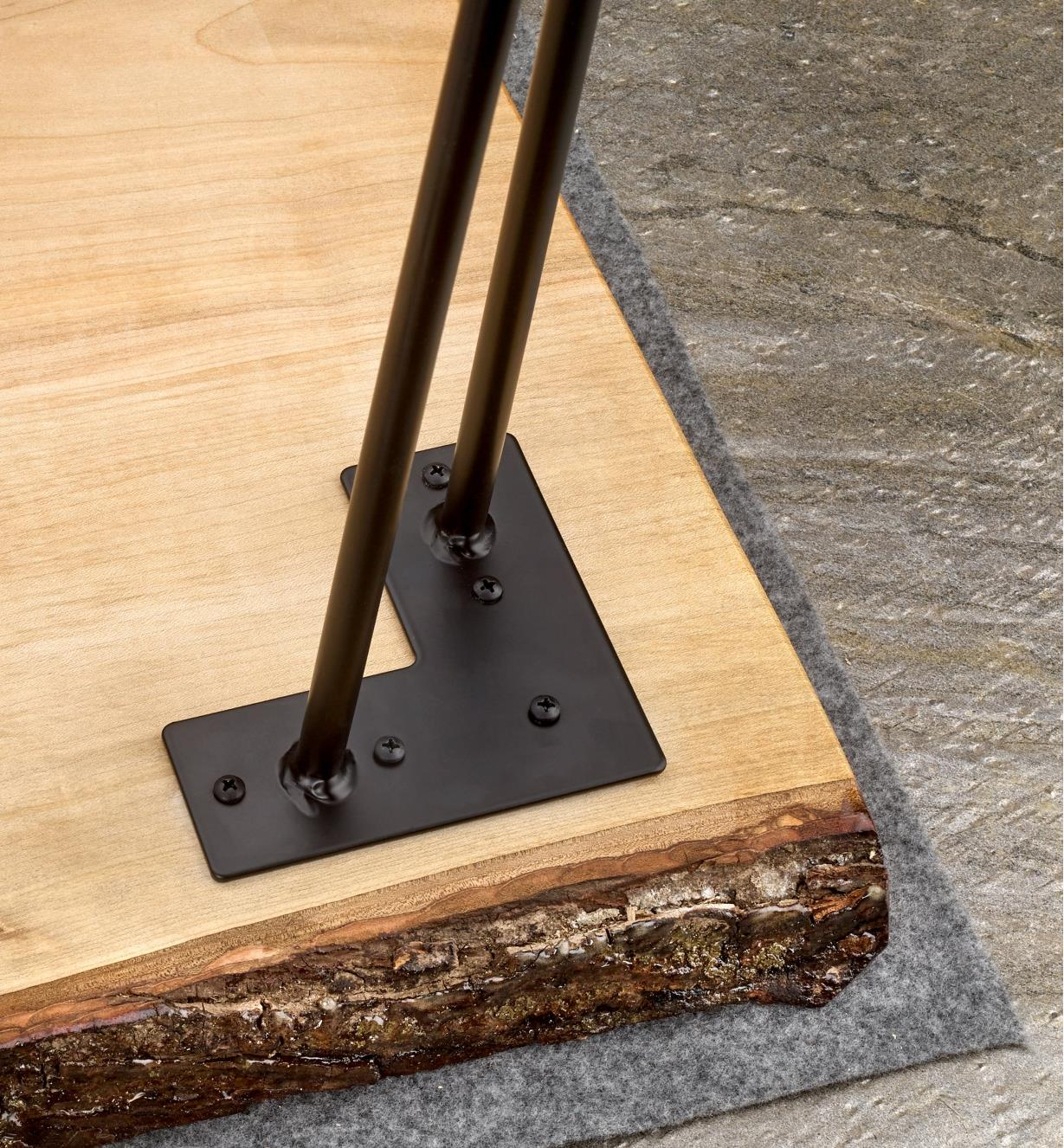 A 16-inch hairpin leg mounted on the corner of a live-edge coffee table