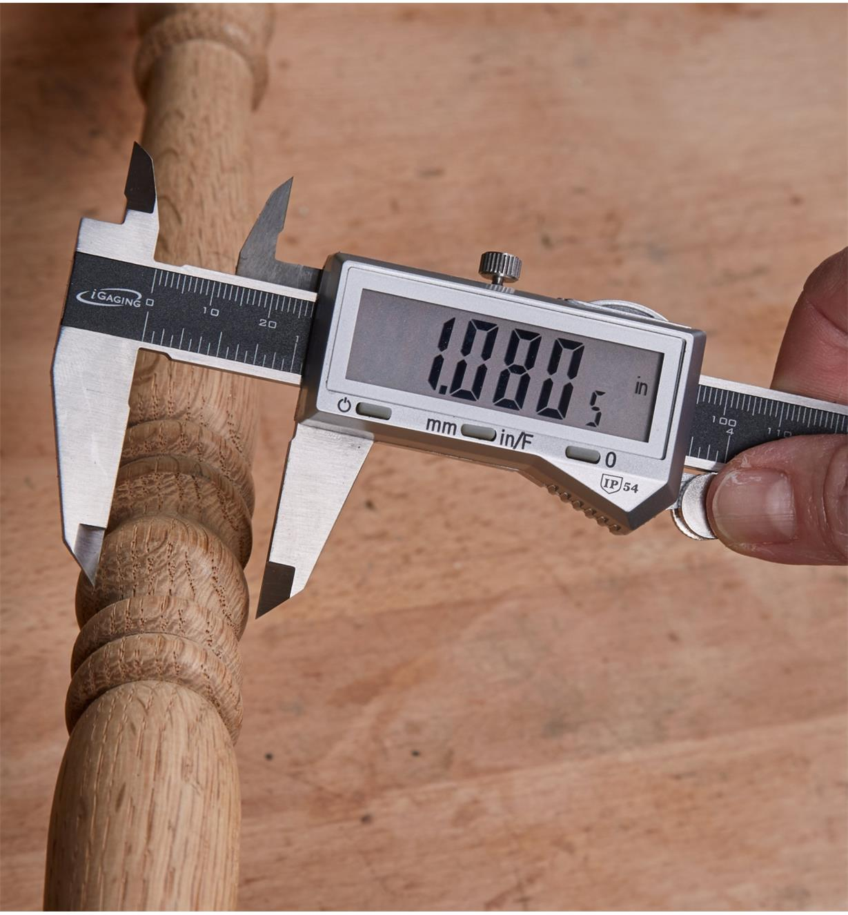 "Measuring the width of a chair spindle with the 6"" Blindman's Caliper"