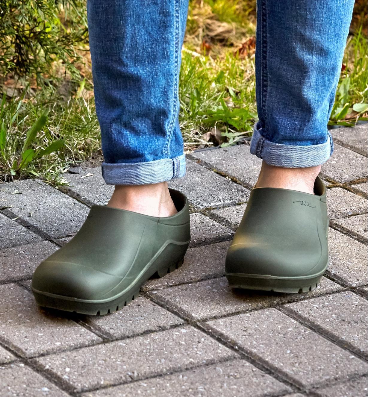 A person wearing European garden clogs
