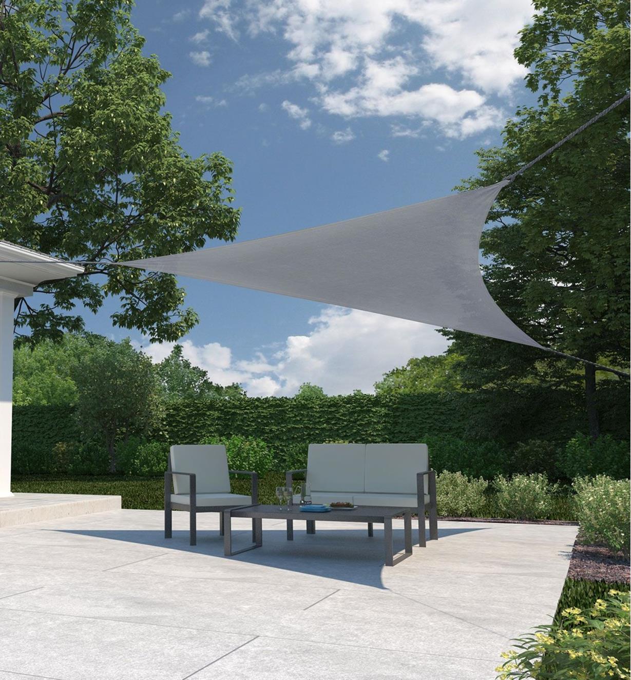 Triangle shade sail providing shade on an outdoor patio