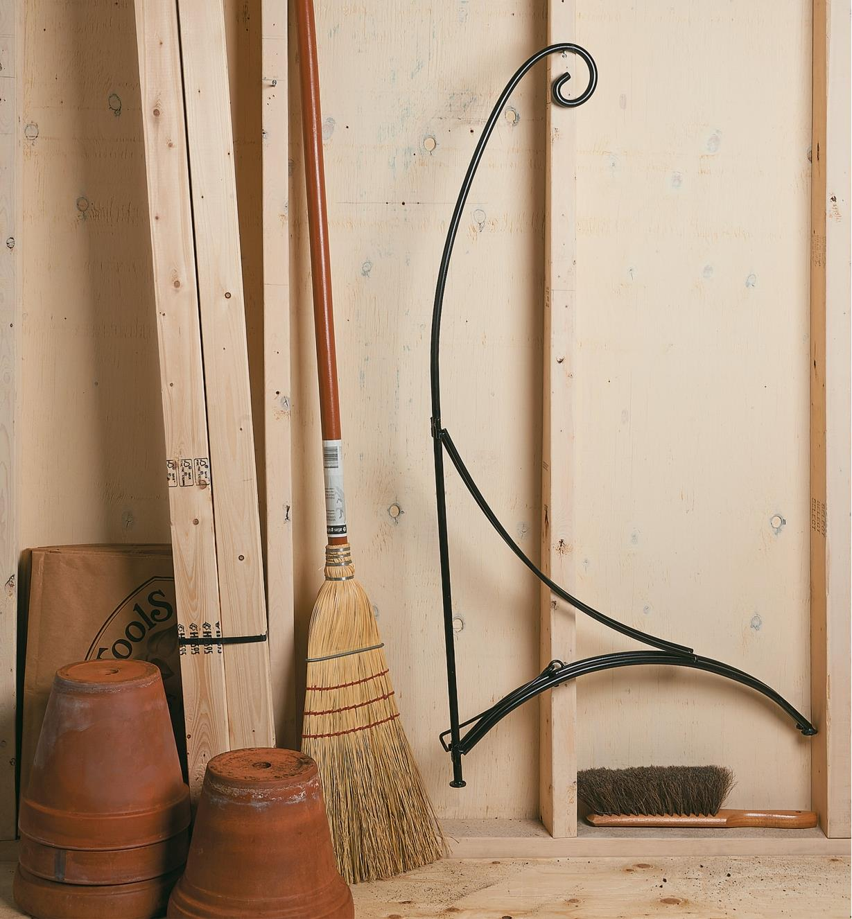 Shepherd's Hook Stand folded against a garage wall