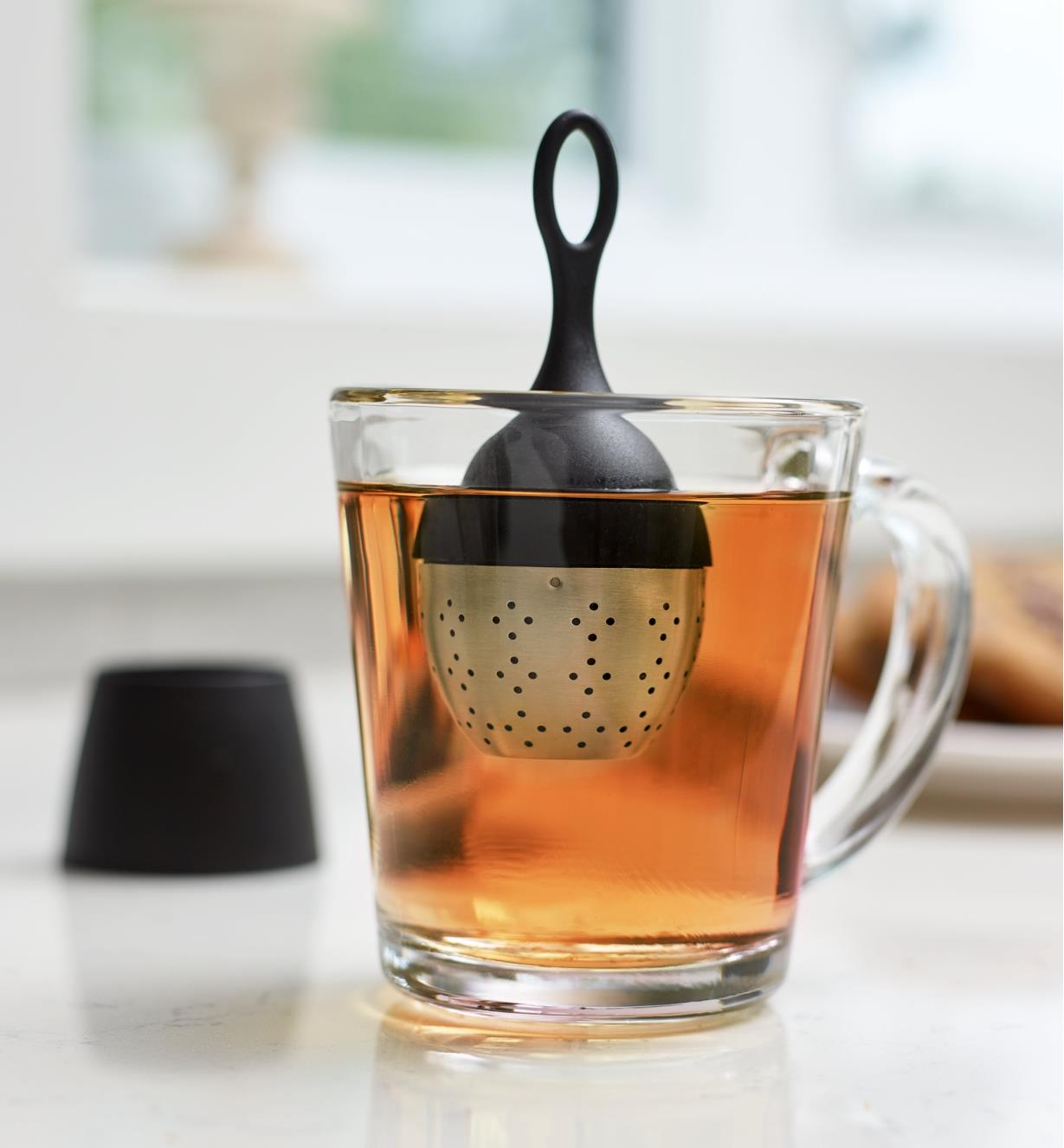 Tea infuser steeping tea in a glass mug