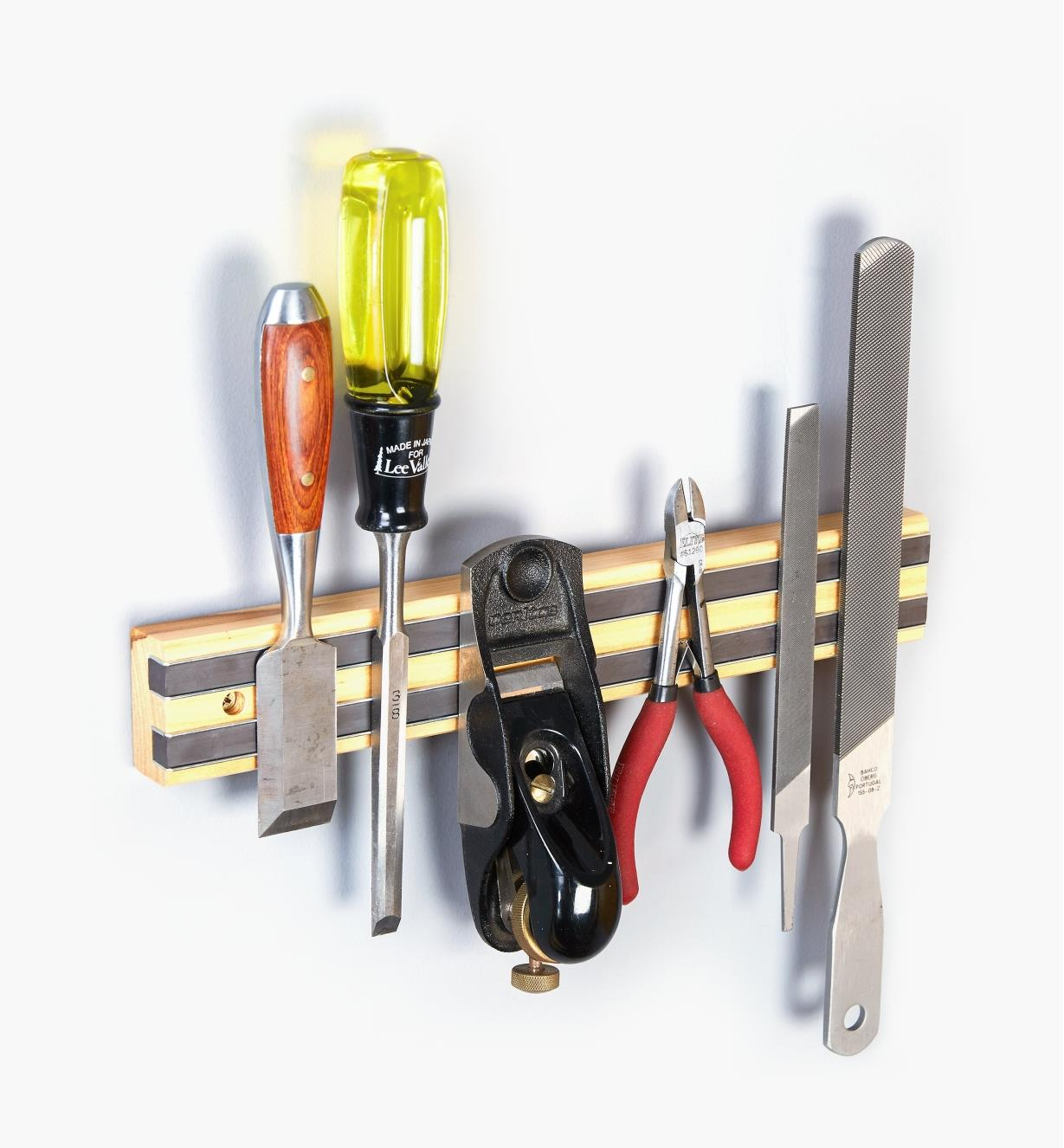 Various hand tools clinging to the Light-Duty Magnetic Tool Bar