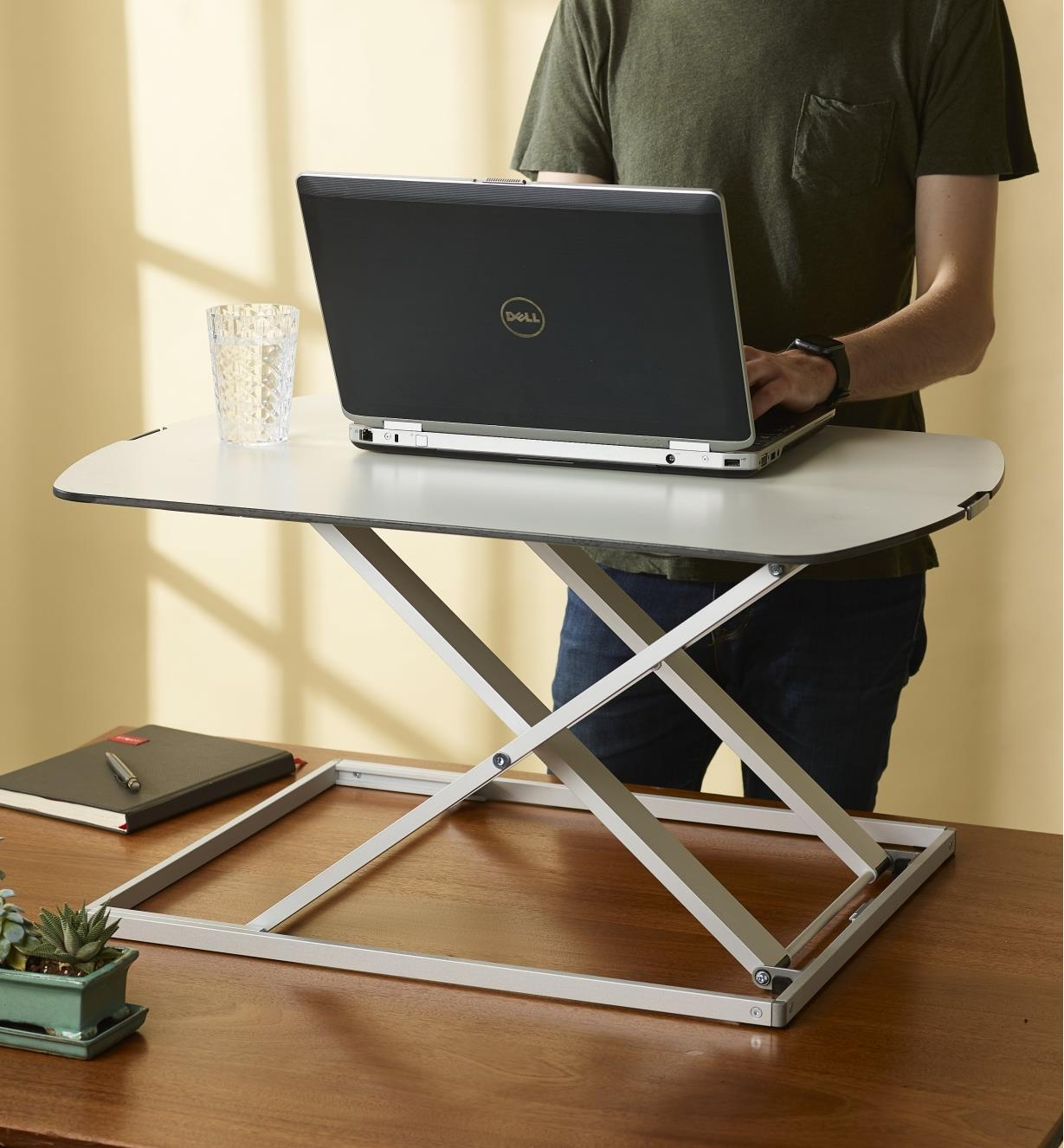 Using a laptop supported on a Height-Adjustable Work Stand