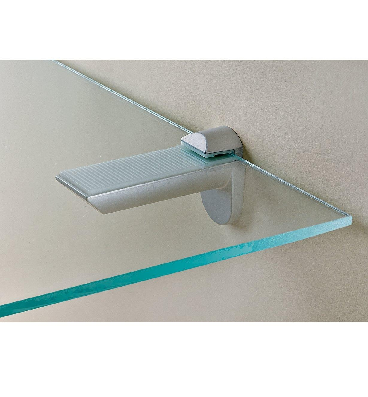 Silver-finish shelf holder holding a glass shelf
