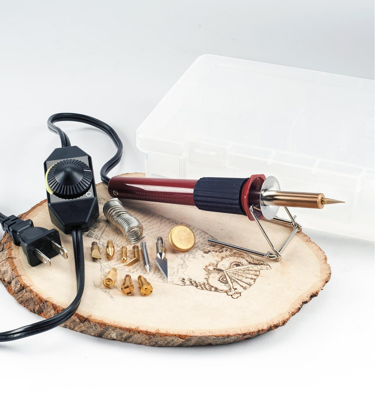 Multi-Function Heat Pen Set sitting on a plaque with an owl image partially burned in