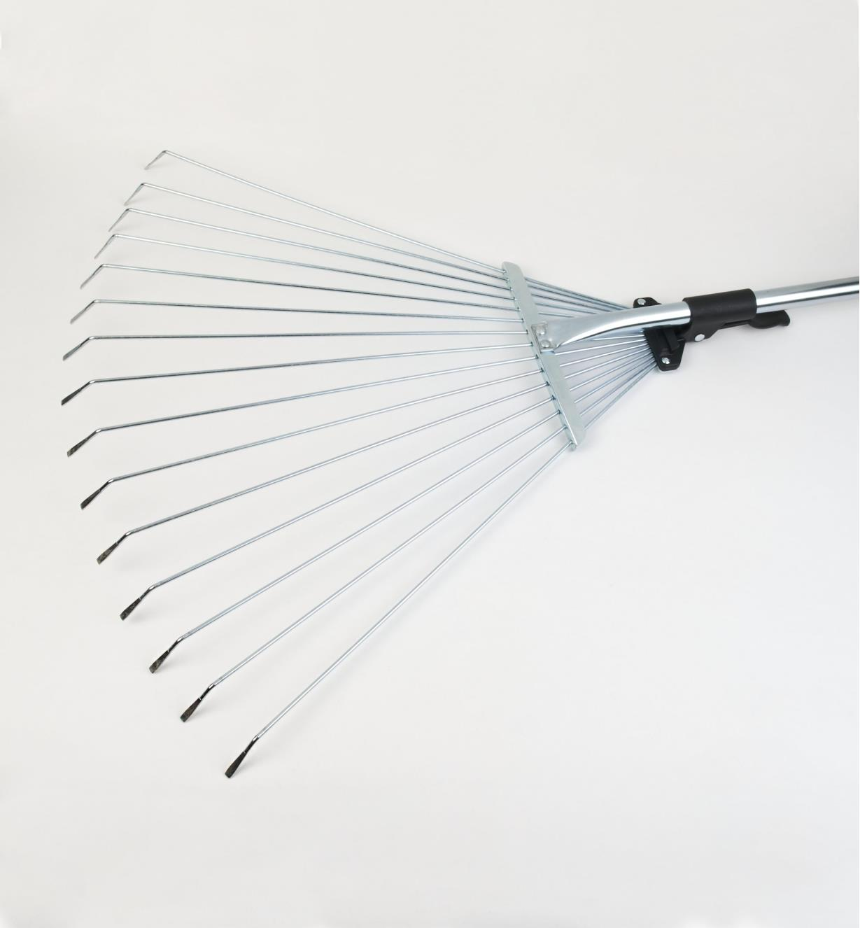 "Tines of long-handled rake shown spread to 22"" wide."