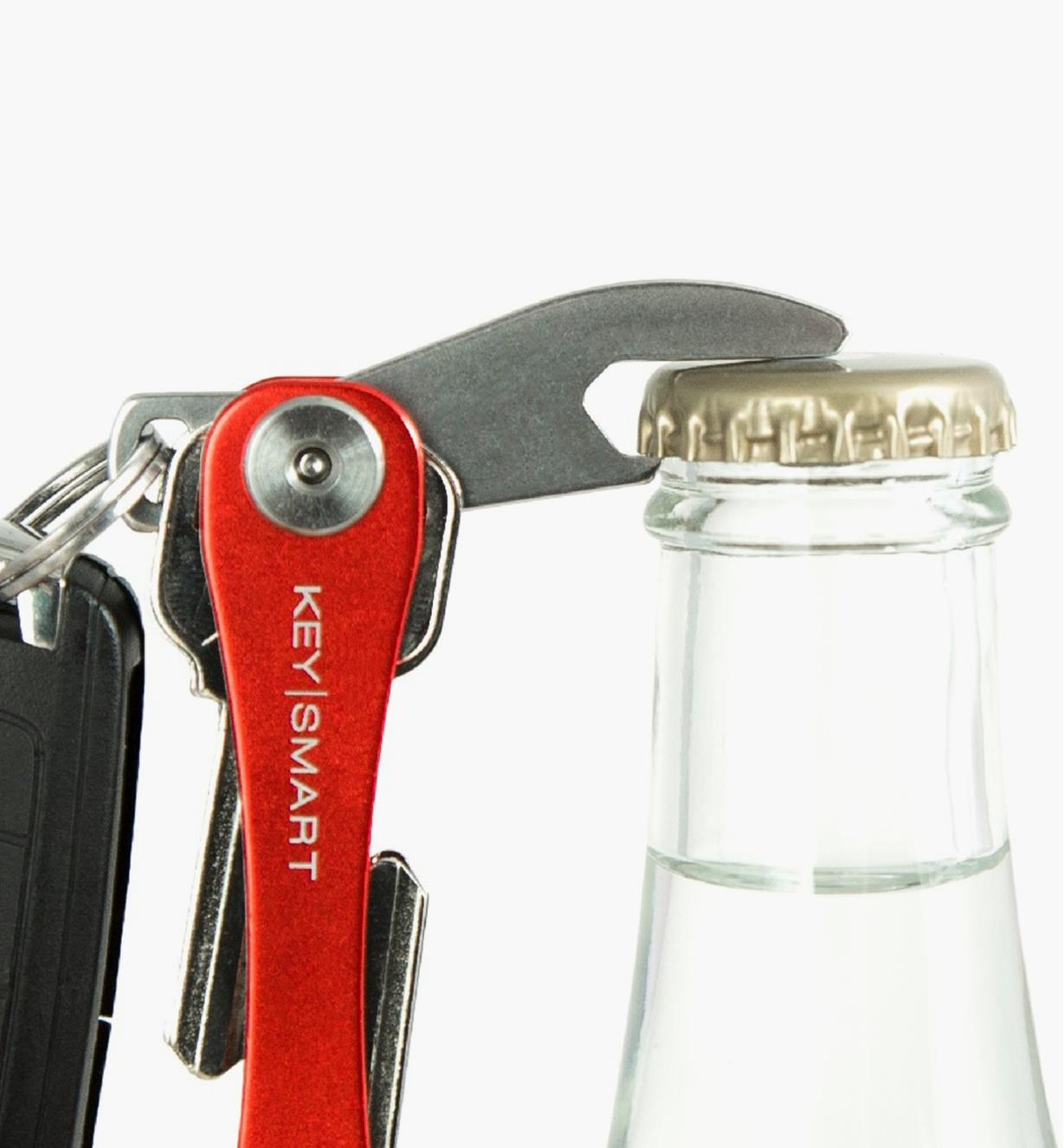 Opening a bottle cap with the KeySmart bottle opener