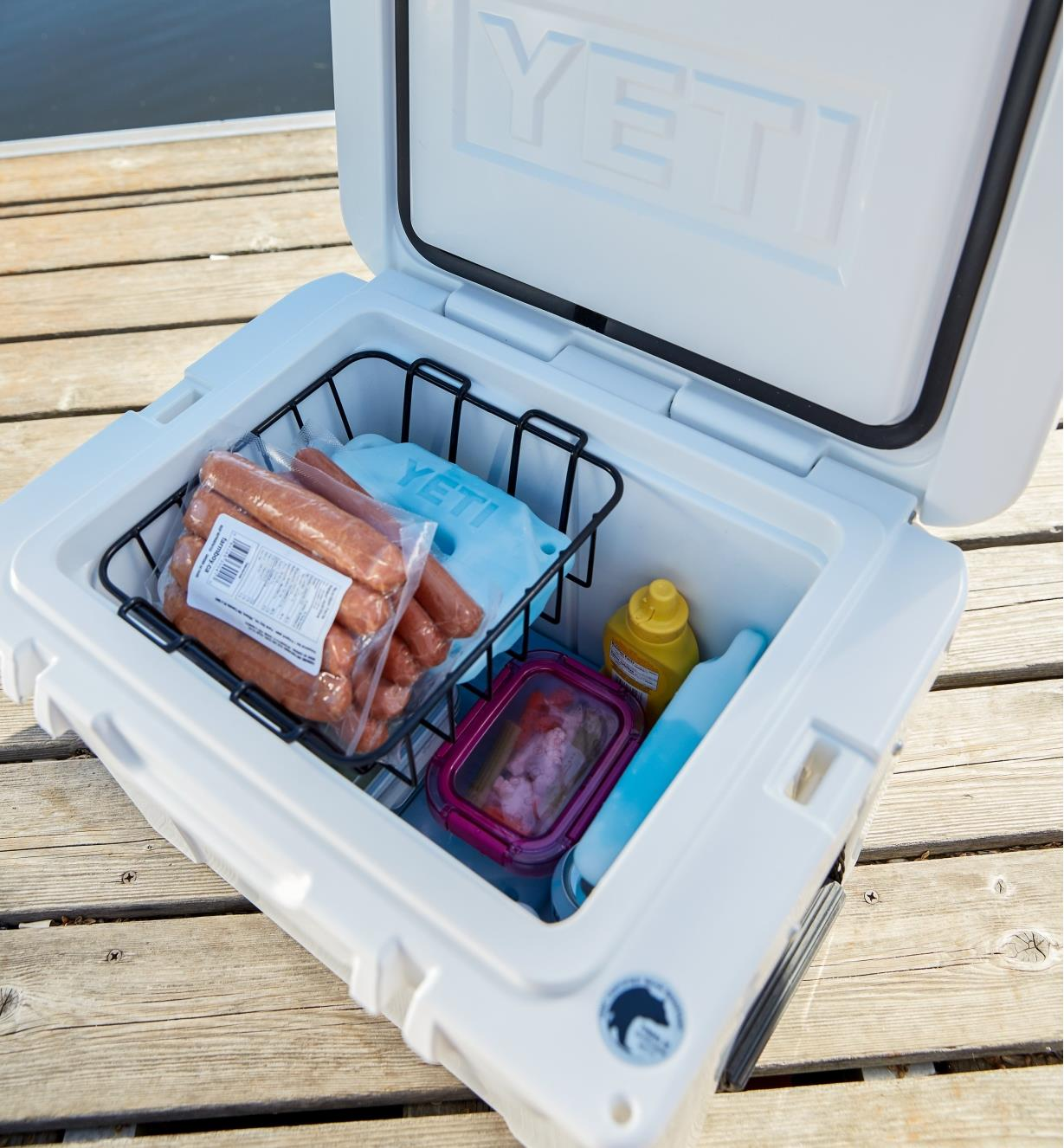 Yeti Tundra Hard-Sided 35 Cooler with lid open, showing food and ice packs inside