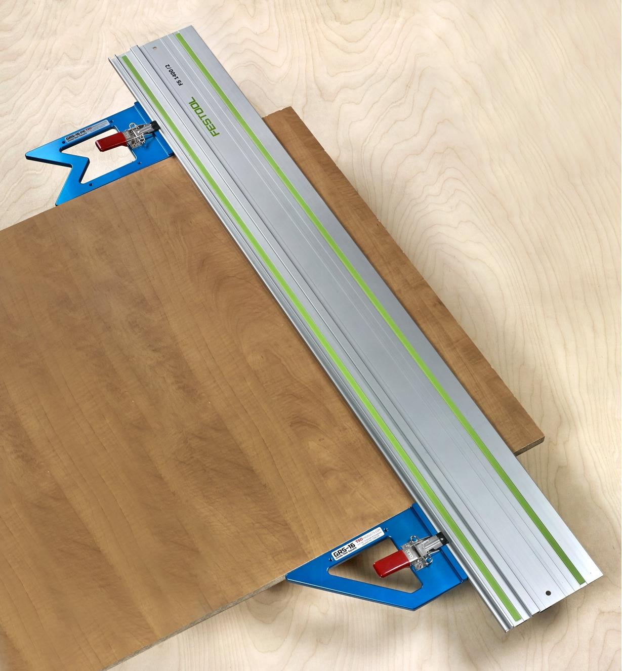 GRS-16 and GRS-PE guide rail squares on a track-saw guide, registered to opposite edges of a panel