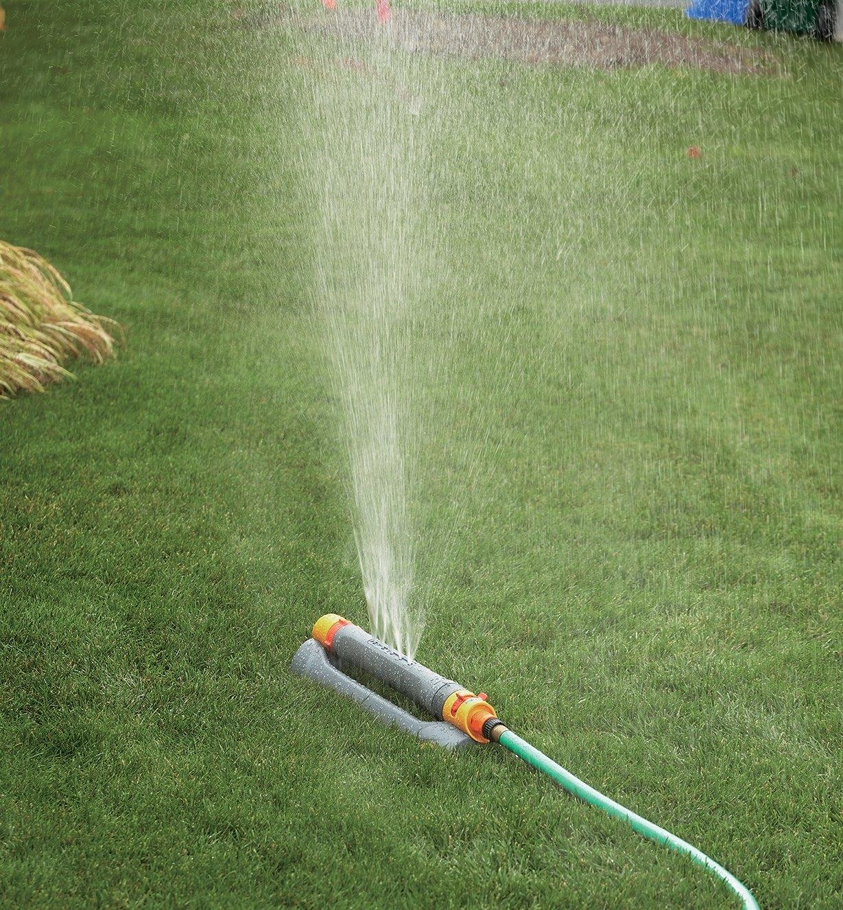 Hozelock Multi-Adjust Sprinkler/Mister watering a lawn with mist spray setting