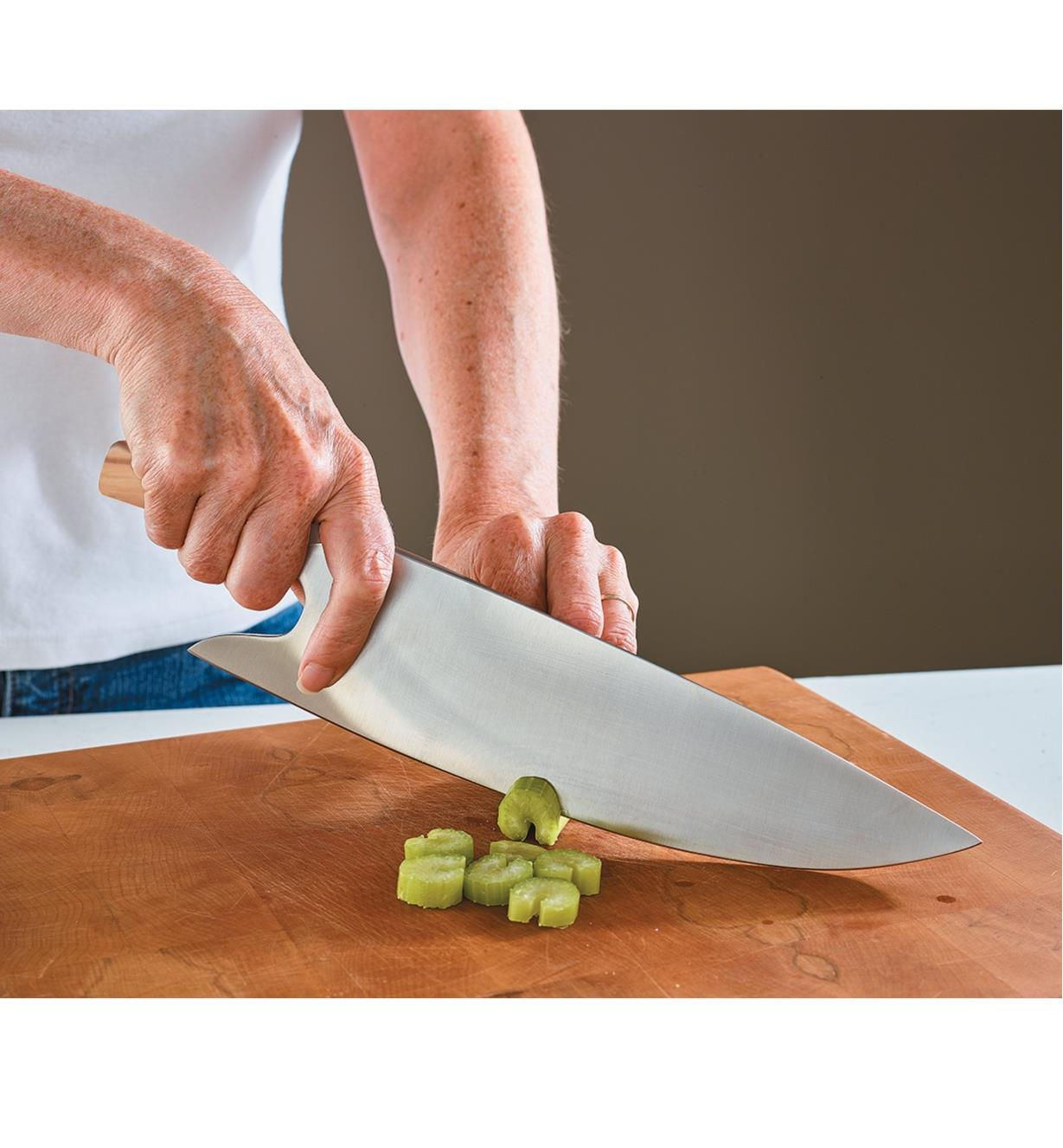 Güde Chef's Knife used to chop celery
