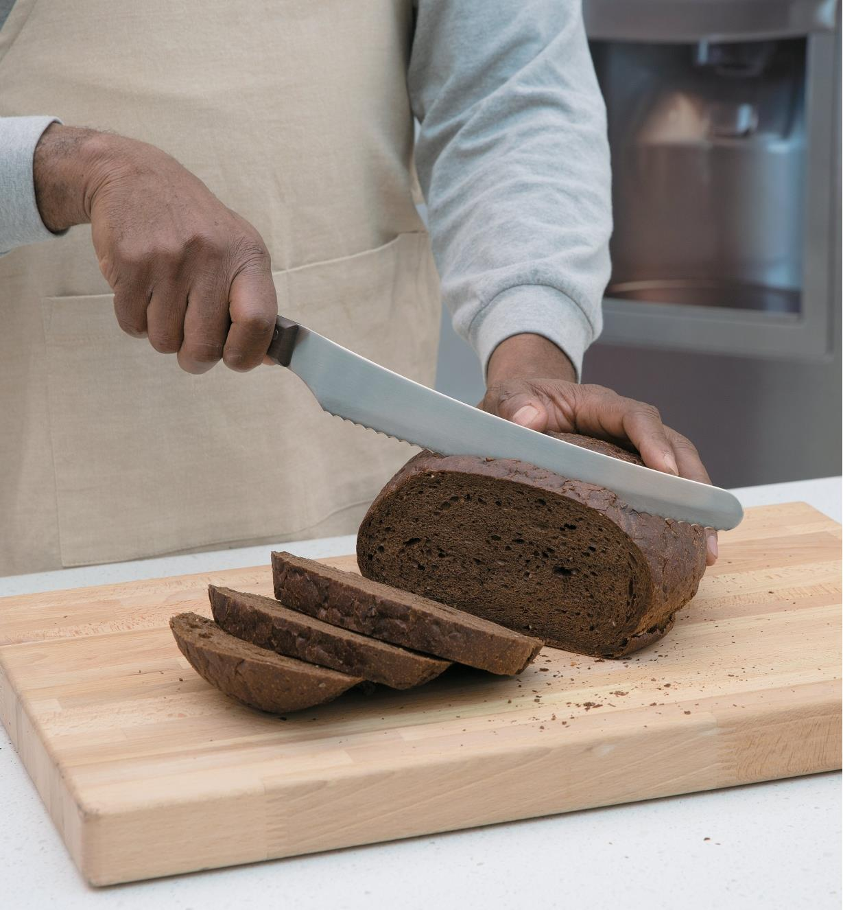 Slicing bread with the Long-Blade Bread Knife