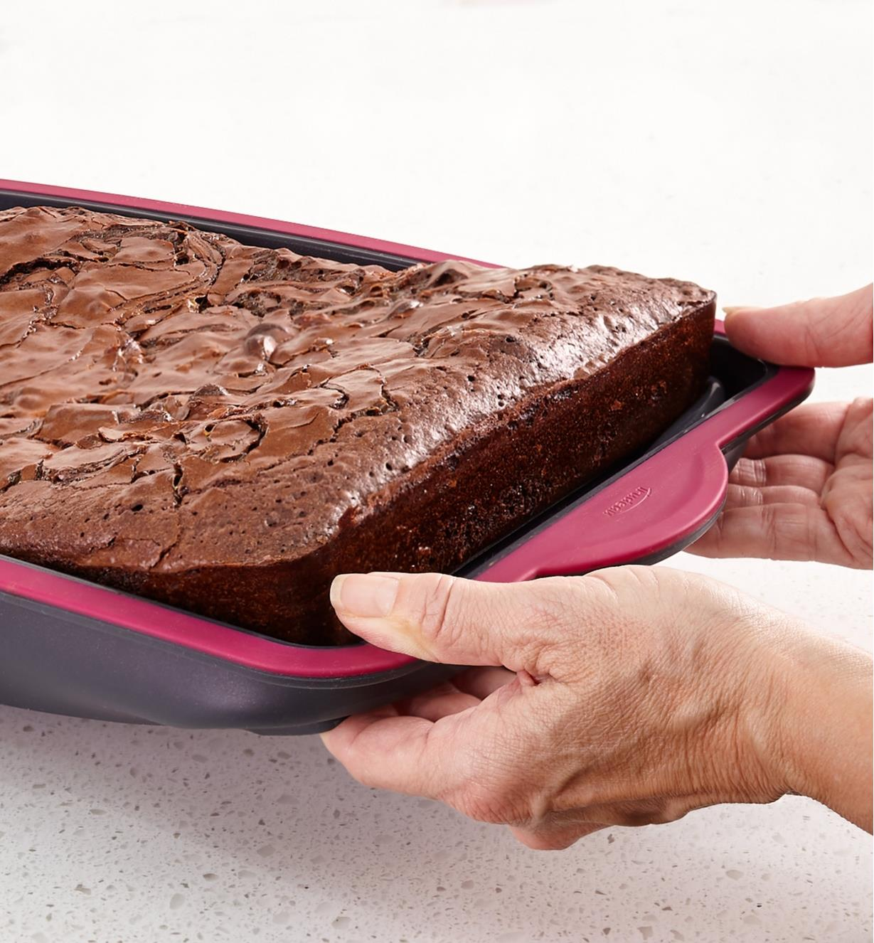 Removing baked brownies by pushing the flexible bottom of the pan upward