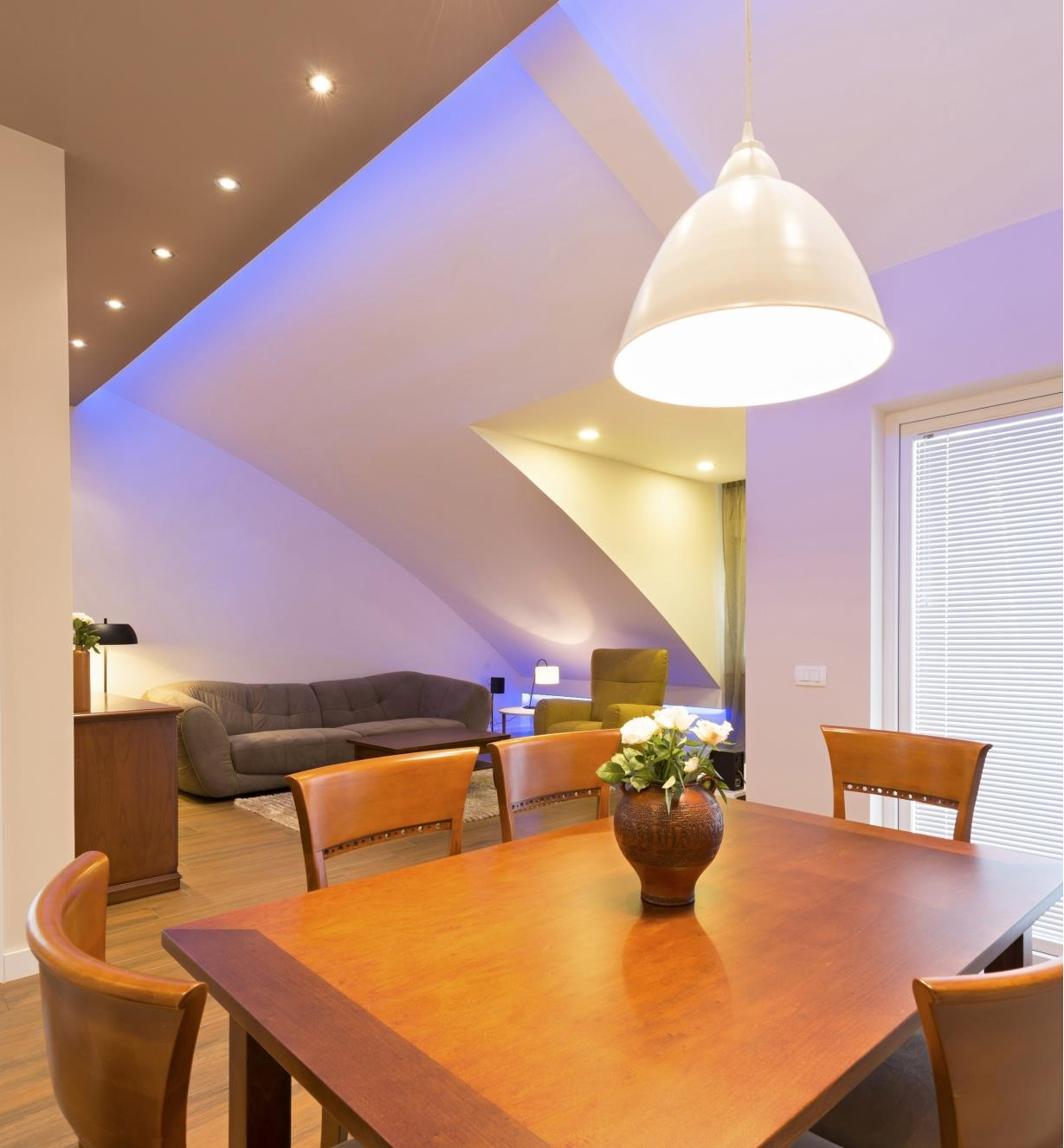 A dining room/living room lit with LED down lights