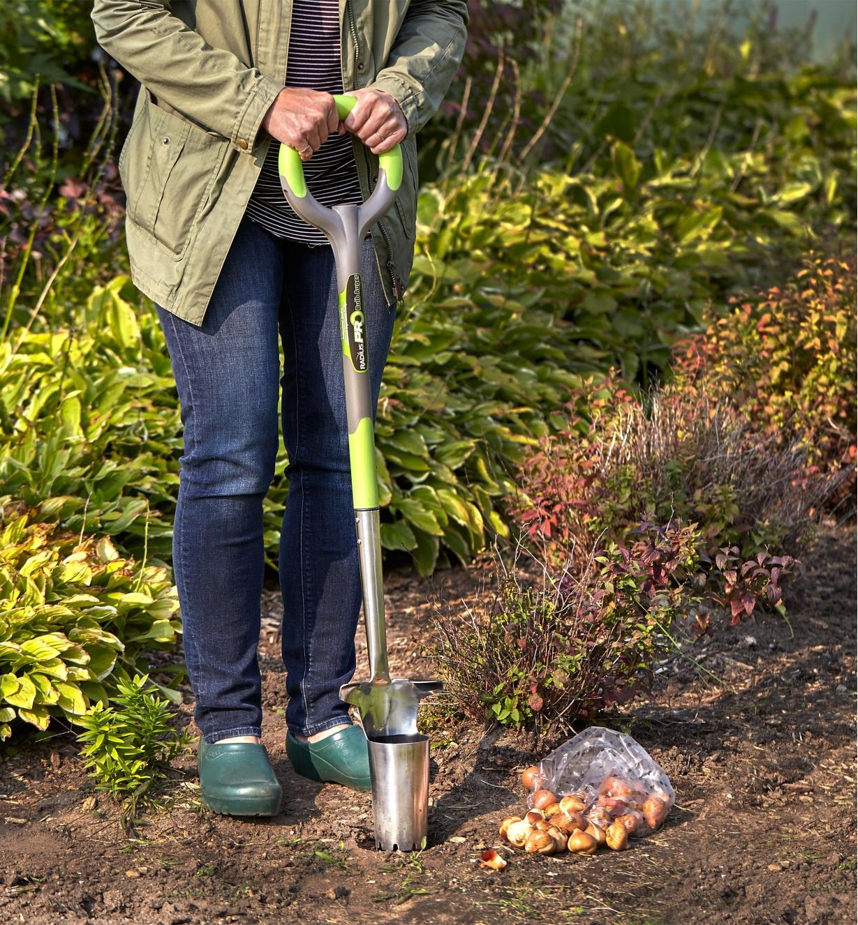 Planting bulbs in a garden with the Radius Ergonomic Stainless-Steel Planter