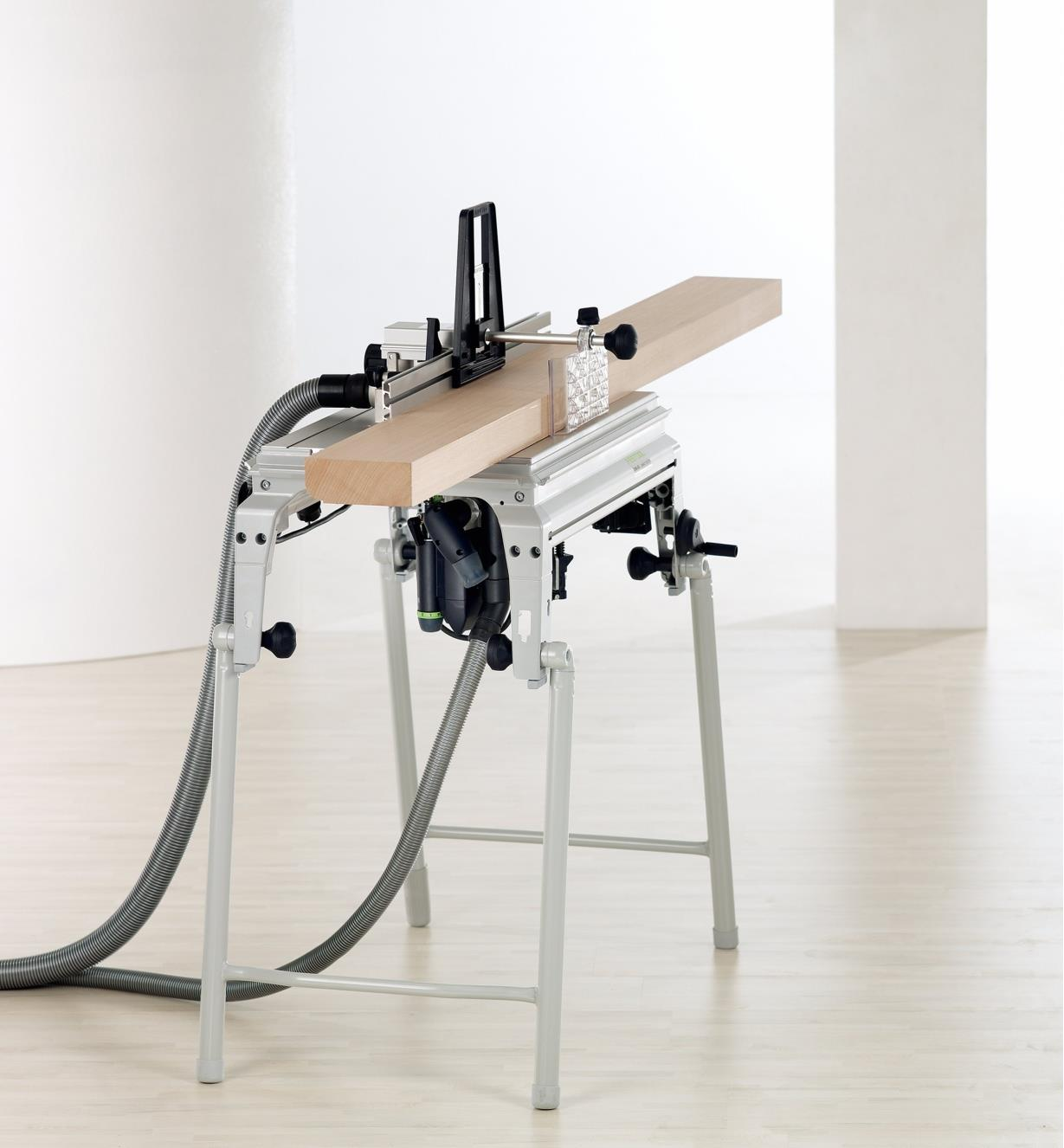 Router table set up to cut an ogee profile along the edge of a board