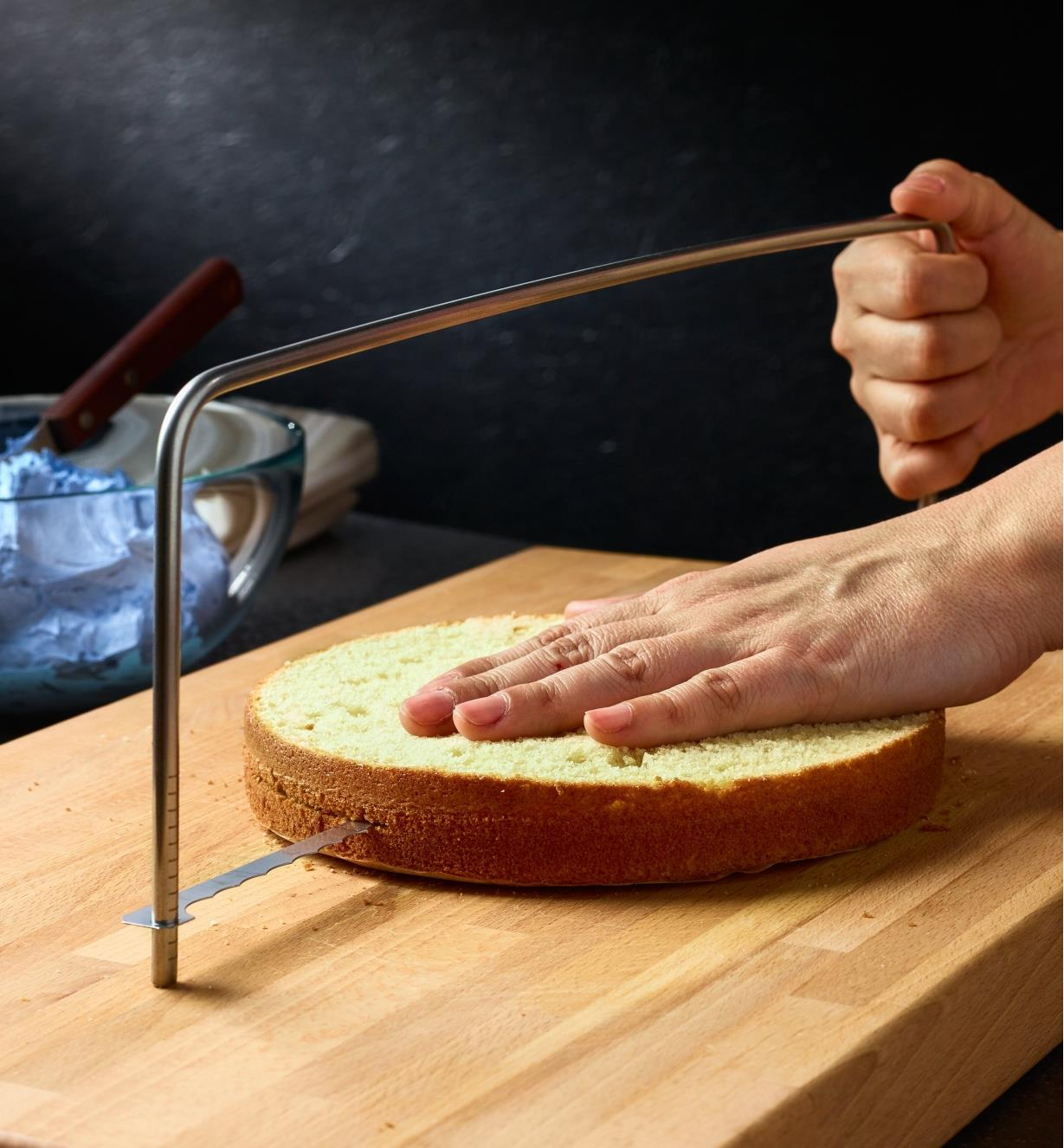 Cutting a round cake in half horizontally using the cake leveller