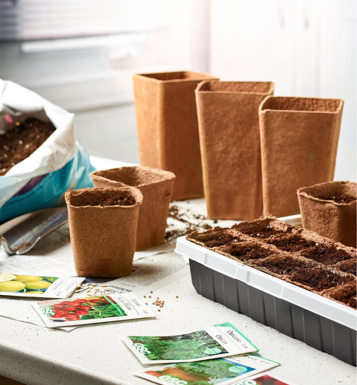 Fiber Pots and grow strips being filled with soil