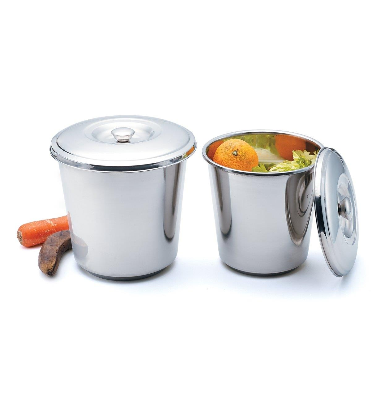 Both sizes of Compost Pails side by side, the smaller pail filled with food scraps