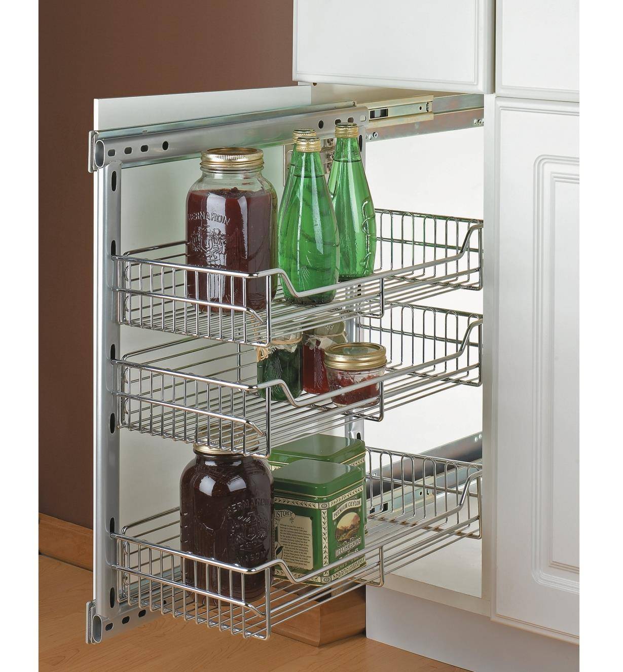 "10"" small side-mount pullout installed in a cabinet, holding jars and bottles"