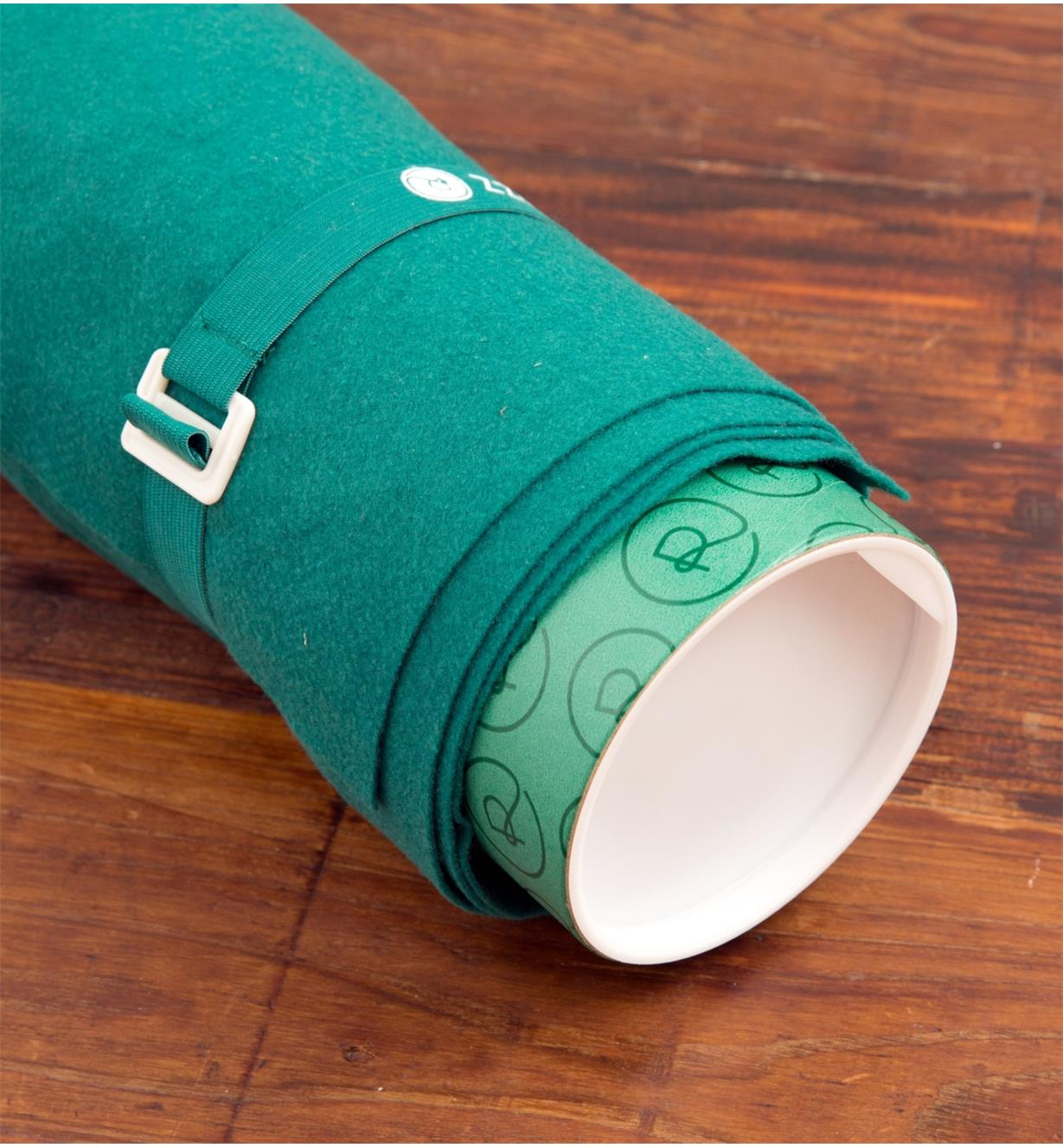 Close-up of one end of the Puzzle Roll when rolled up with strap in place