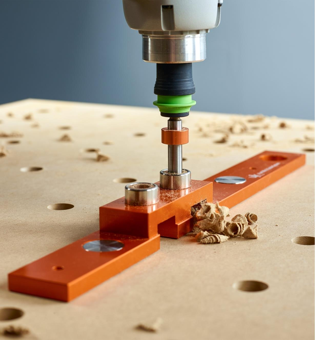 Drilling into a work surface using the guide block and 20mm drill bit
