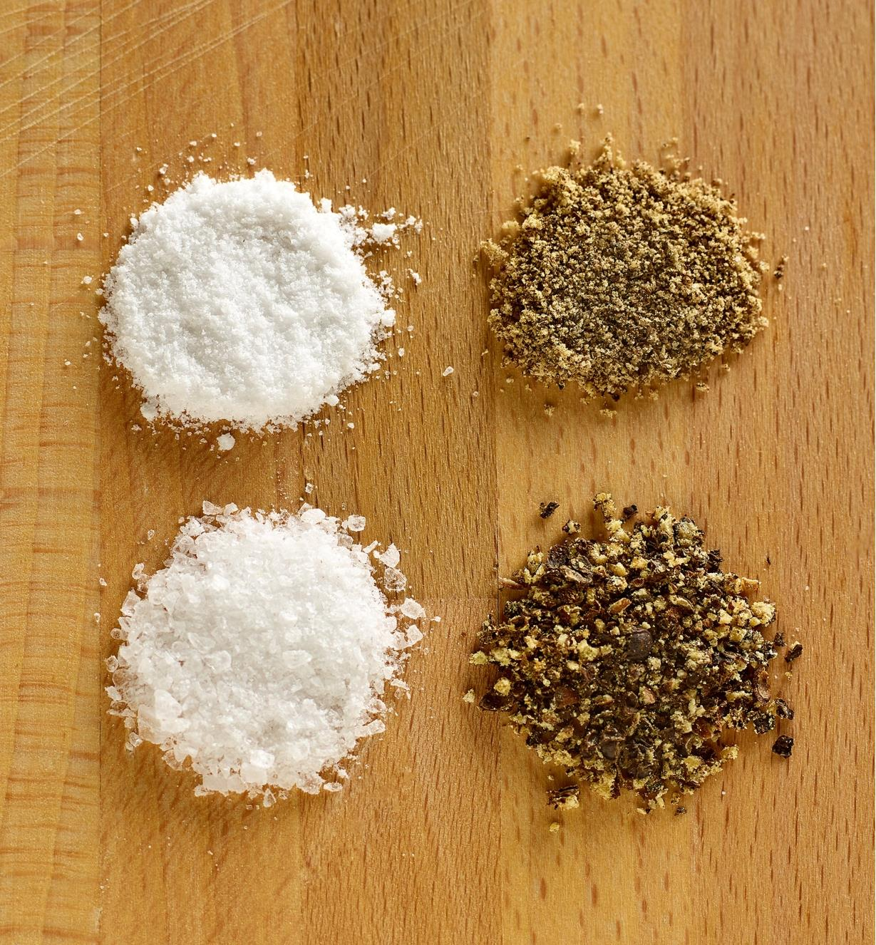 A close view of coarse- and fine-ground salt and pepper, showing the range of grind settings