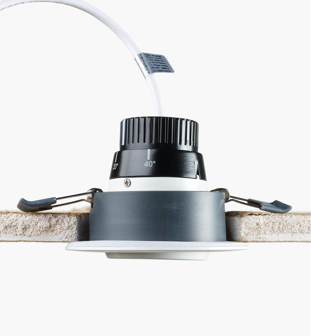 Cutaway view of Adjustable-Beam LED Spotlight installed in a ceiling