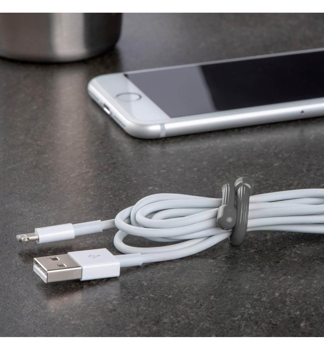 "3"" gray gear tie used to bundle a cell phone charging cord"