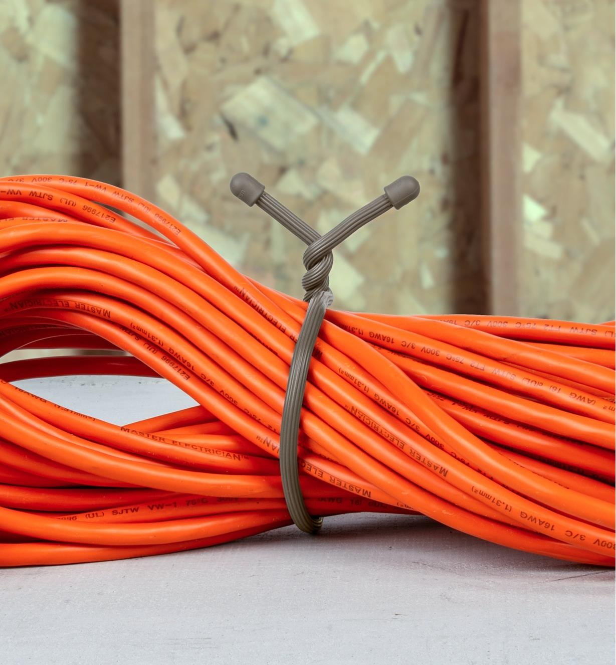 "18"" taupe gear tie used to bundle a long extension cord"