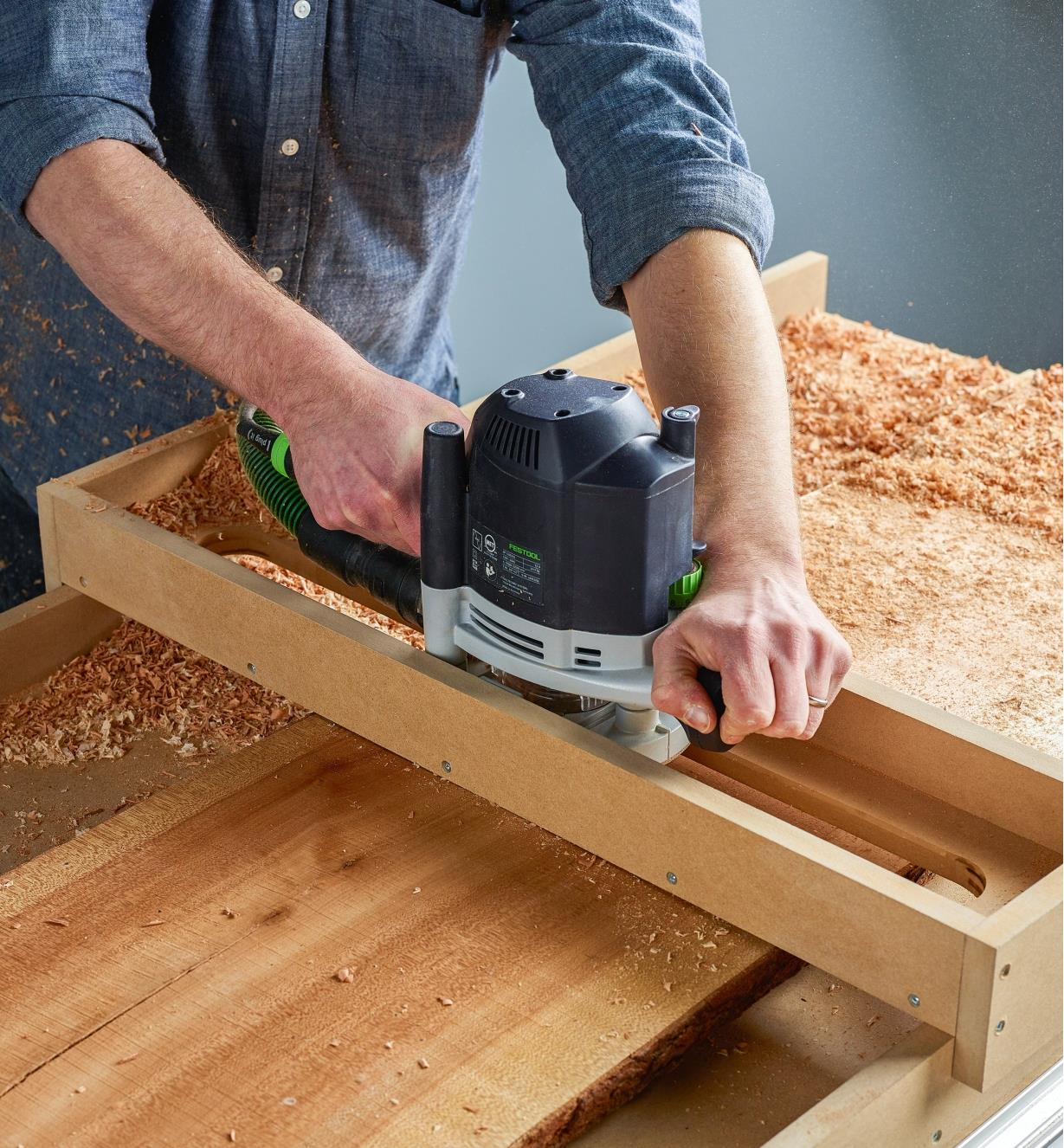 Used with a router sled, a router with a flattening bit is passed across a wood slab to flatten it