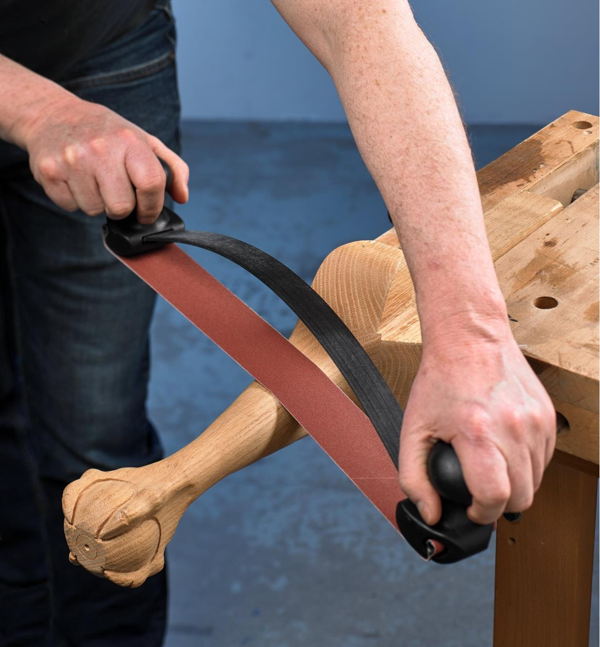 Sanding a chair leg with the Large Bow Sander