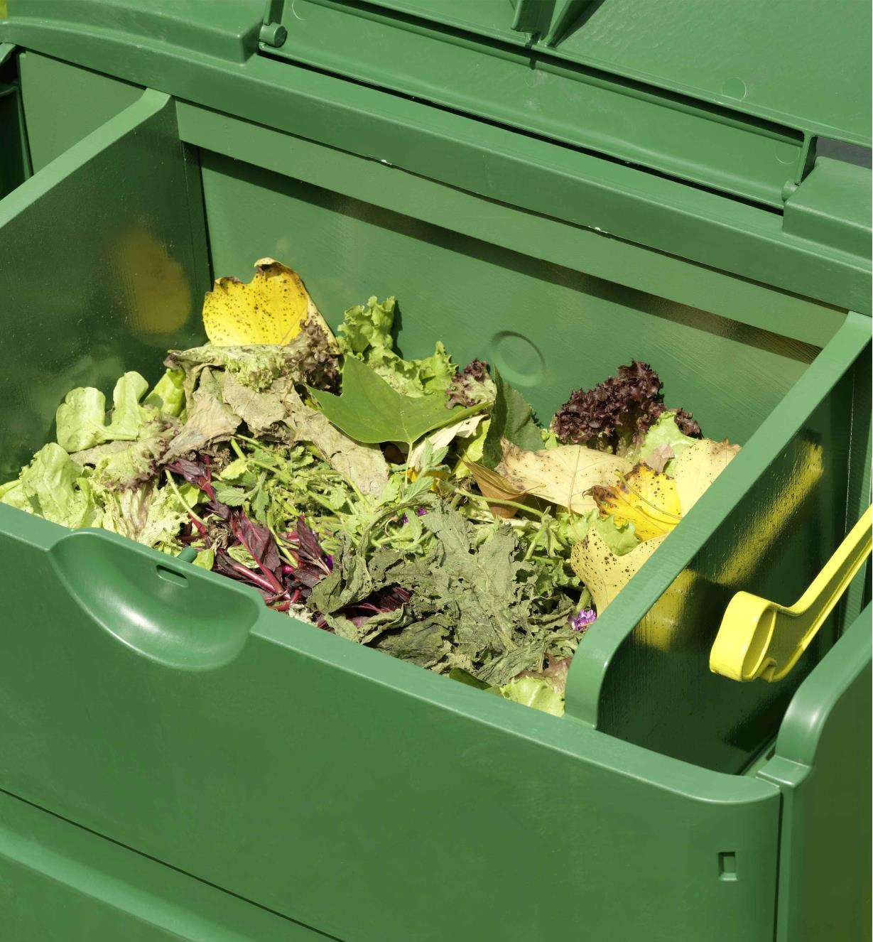 Top compartment filled with food waste